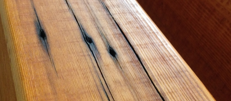 Oxide stains, nail holes, and deep checks as well as color changes due to seasoning are only a few of the details that stand out in genuine reclaimed lumber.