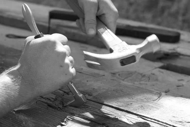 Removing-metal-from-reclaimed-wood-beams-i.jpg