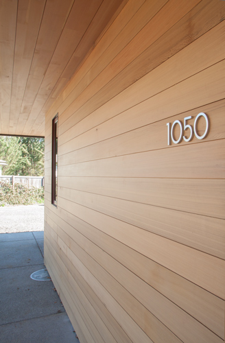 This house has reclaimed cedar siding and reclaimed  Grandstand Fir  soffit with a matte clear finish to protect the wood. The deep overhangs also provide shelter to extend the life of this installation.
