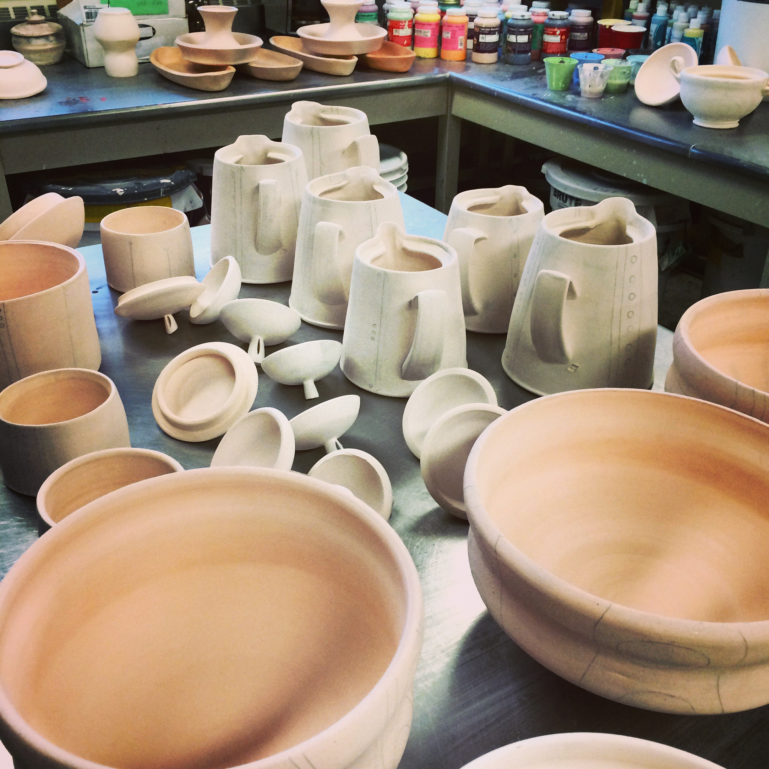 Lots of bisqueware waiting for their coats of liquid glass.