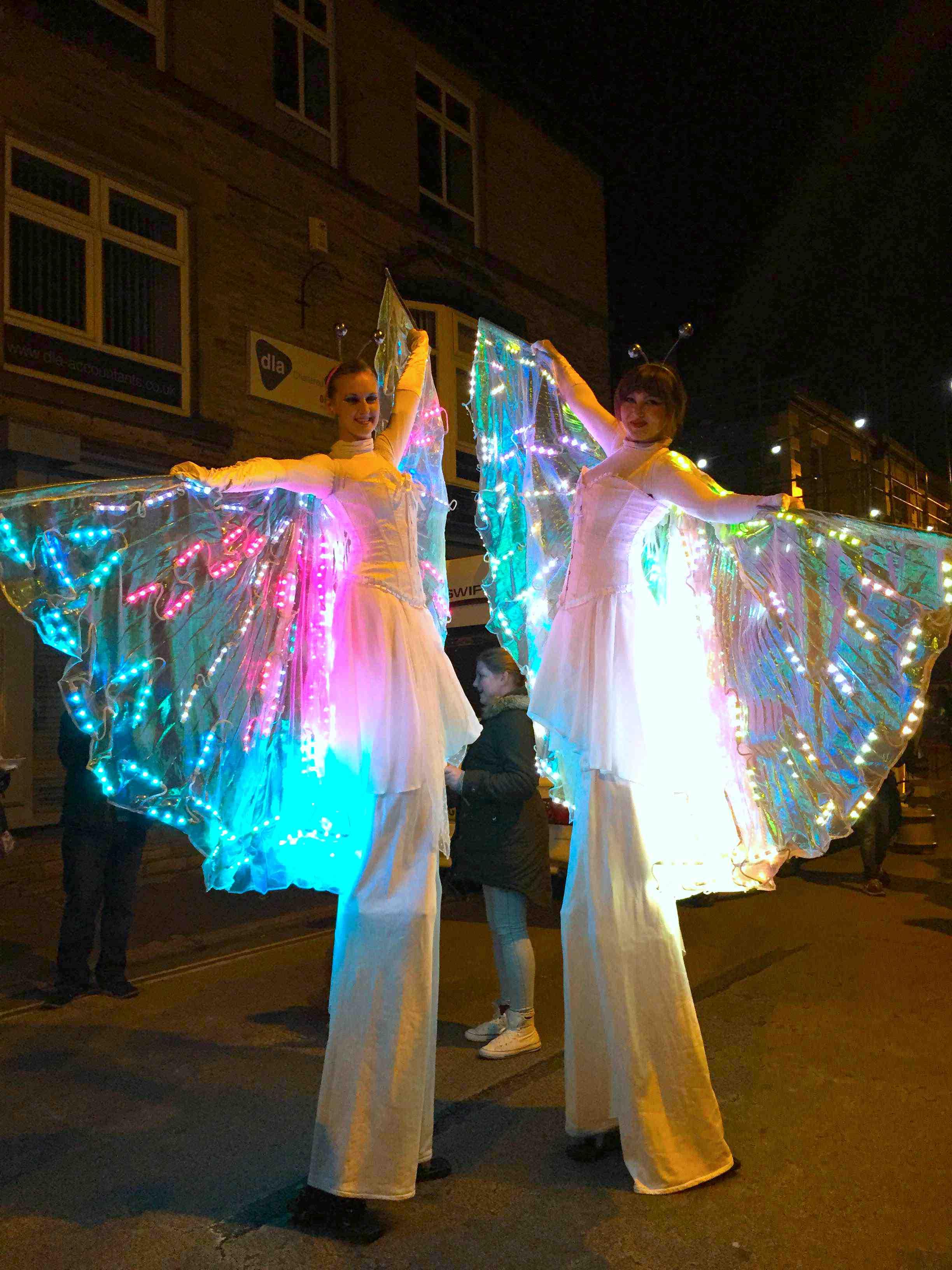 Glow butterfly stilt duo.jpg