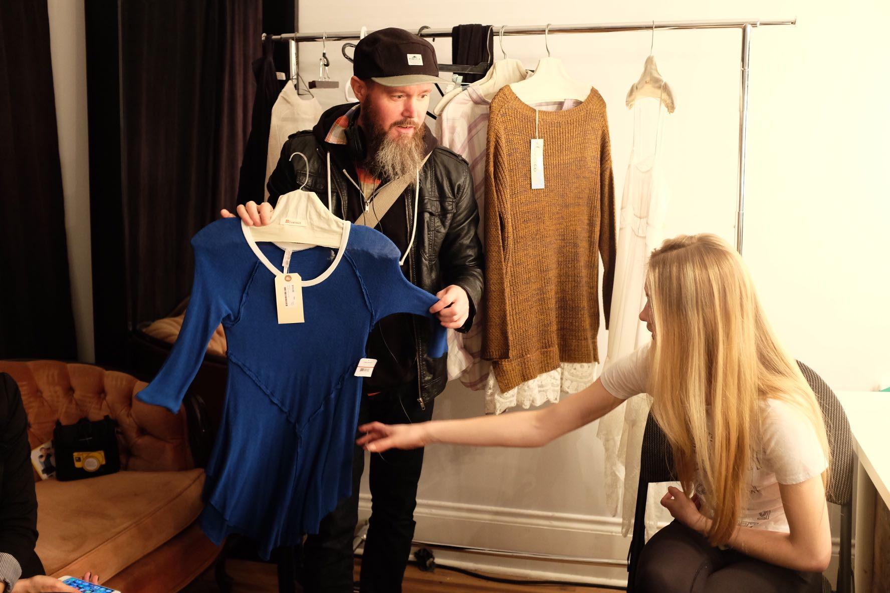 Stylist Jacob Connell showing off some of the Free People garments while Shannon gets makeup done.