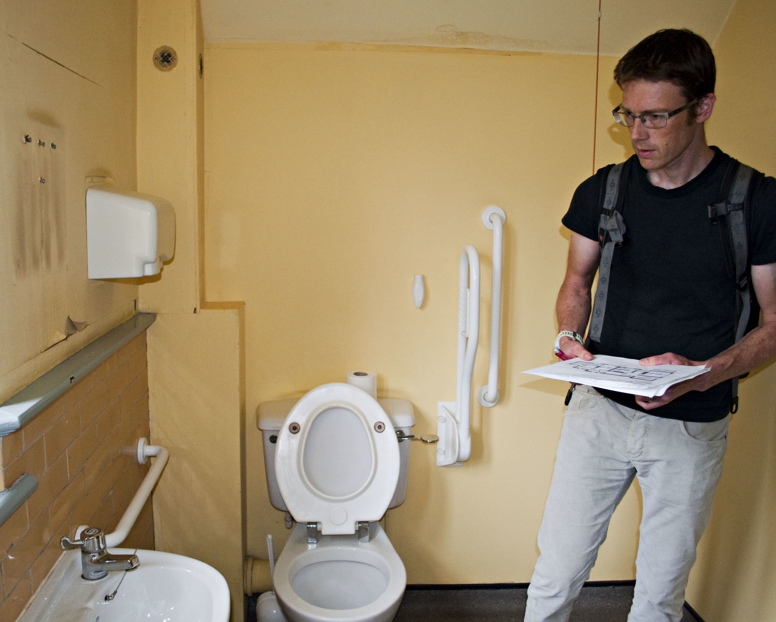Dunc sizing up the bathroom back in September, before we bought the house.