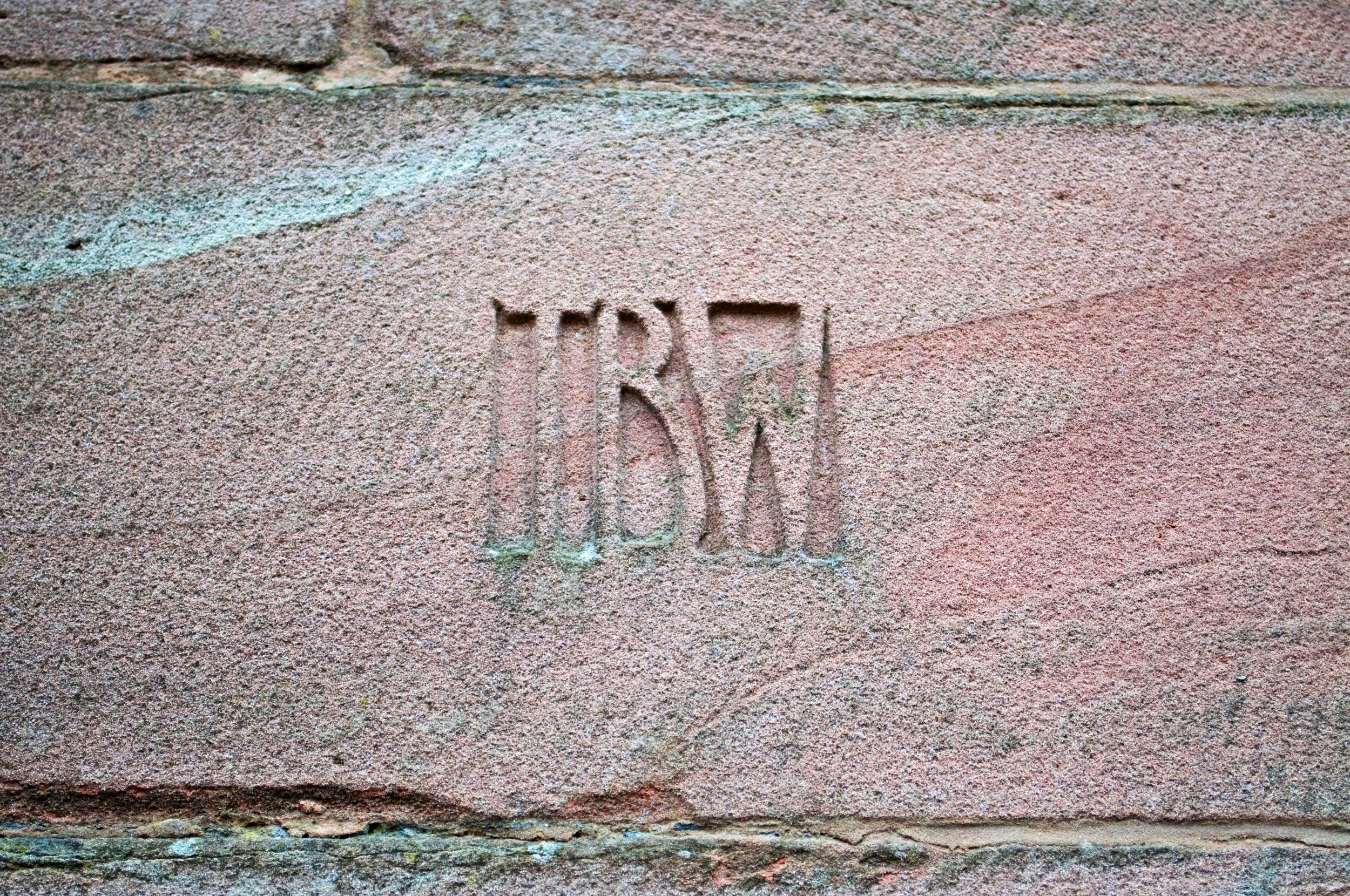 Edgar Wood's father's initials carved into the building - along with those of the other patrons who helped fundthe build