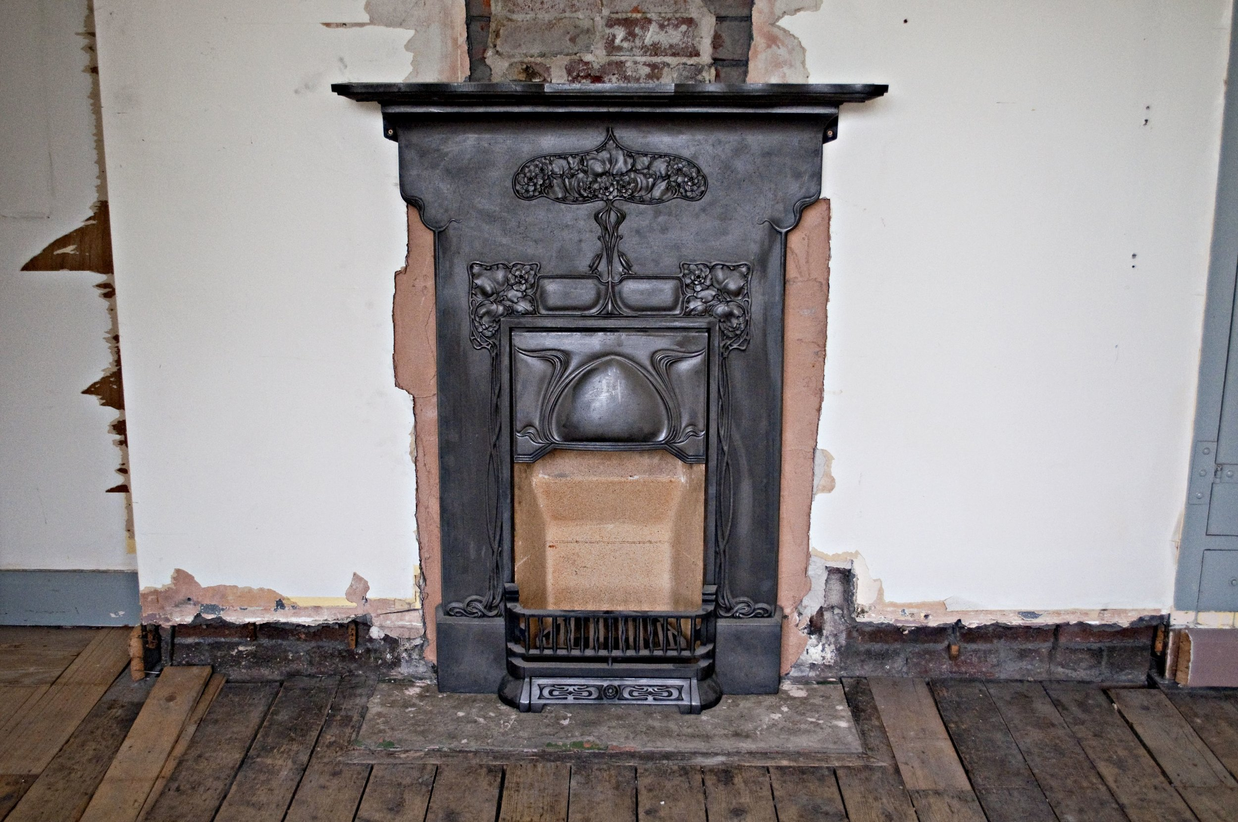 Another reclaimed fireplace installed...love the roses on this