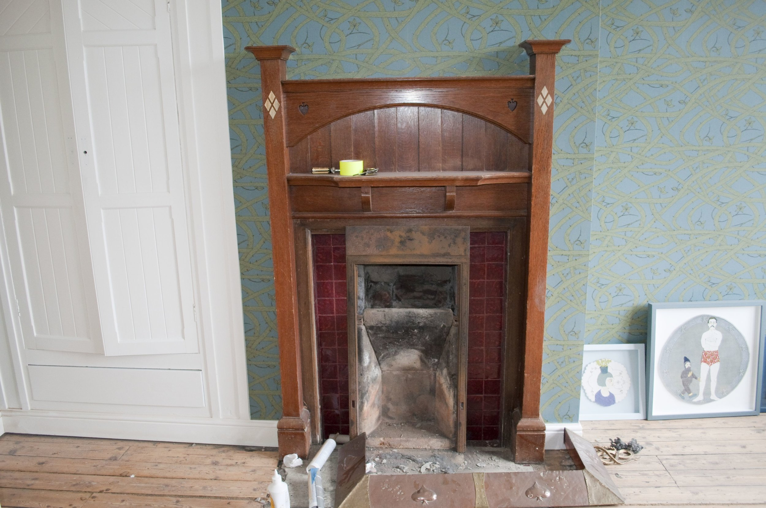 Bedroom fireplace waiting for its new insert