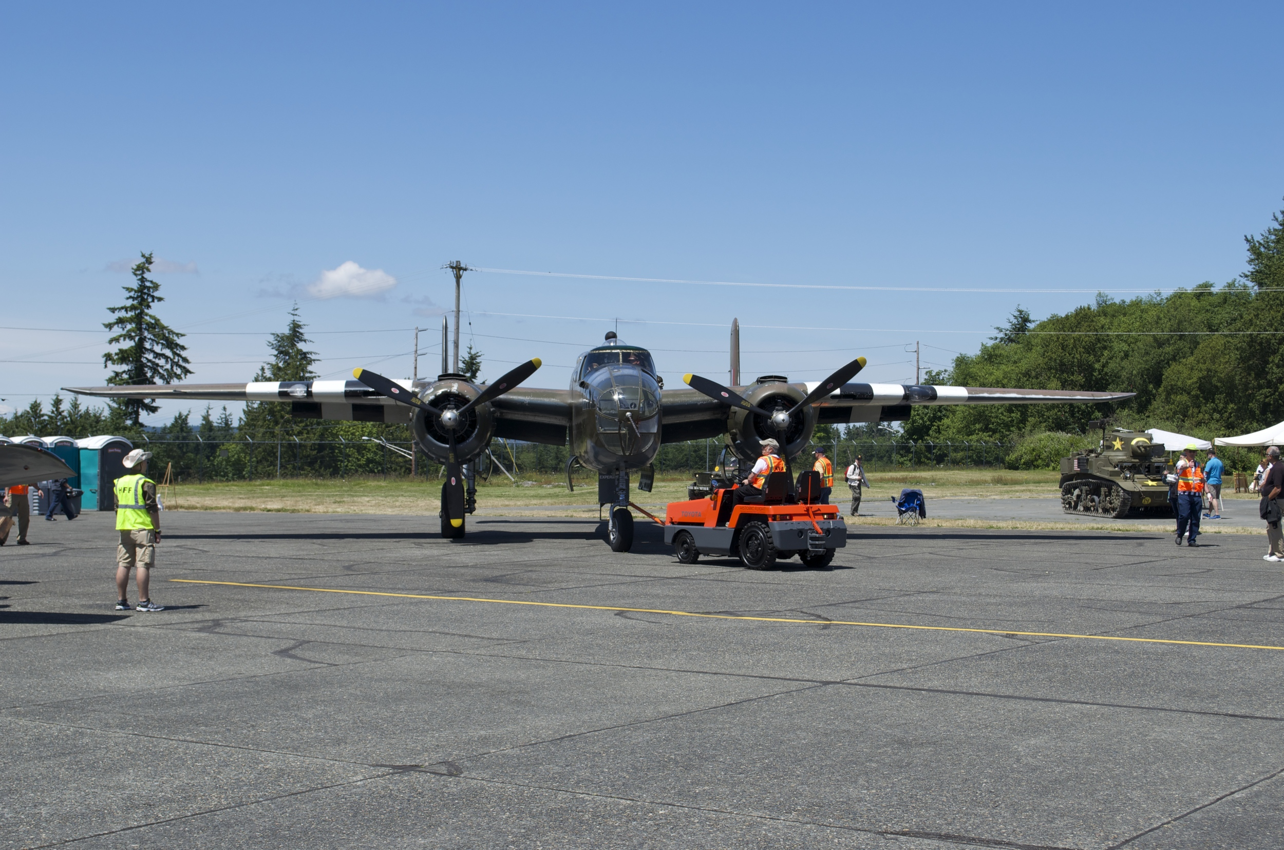 """A tug tows """"Grumpy"""", the B-25 Mitchell, into position for takeoff from the Historical Flight Foundation at Paine Field."""