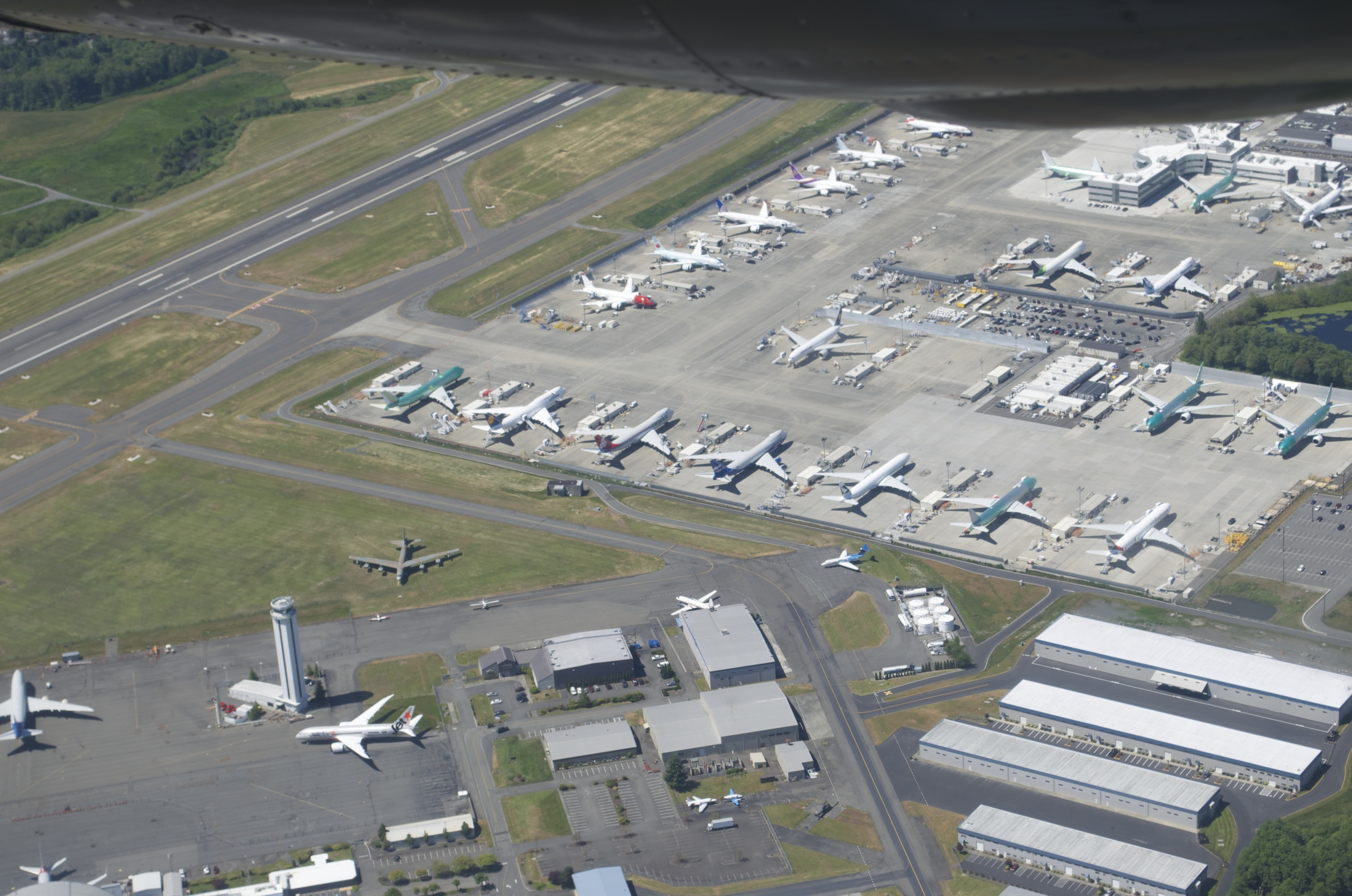 Circling Paine Field- B-52 on the grass among the commercial jets being prepared for delivery.