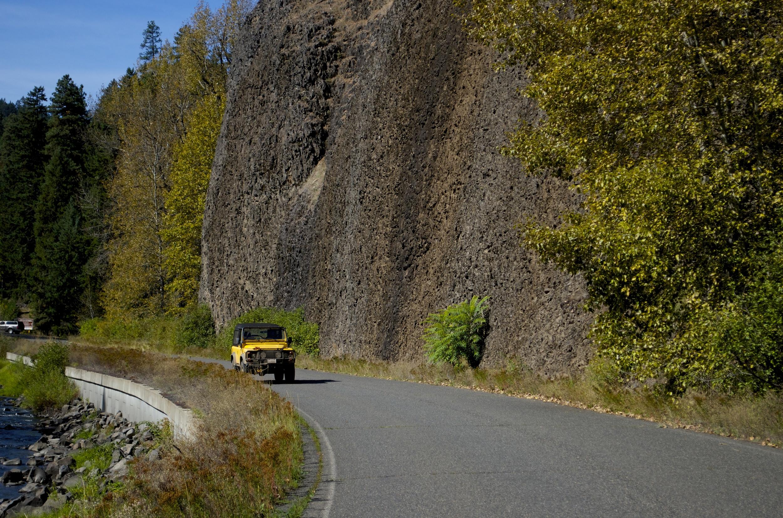 Lar zooms past basalt cliffs above the Little Naches River