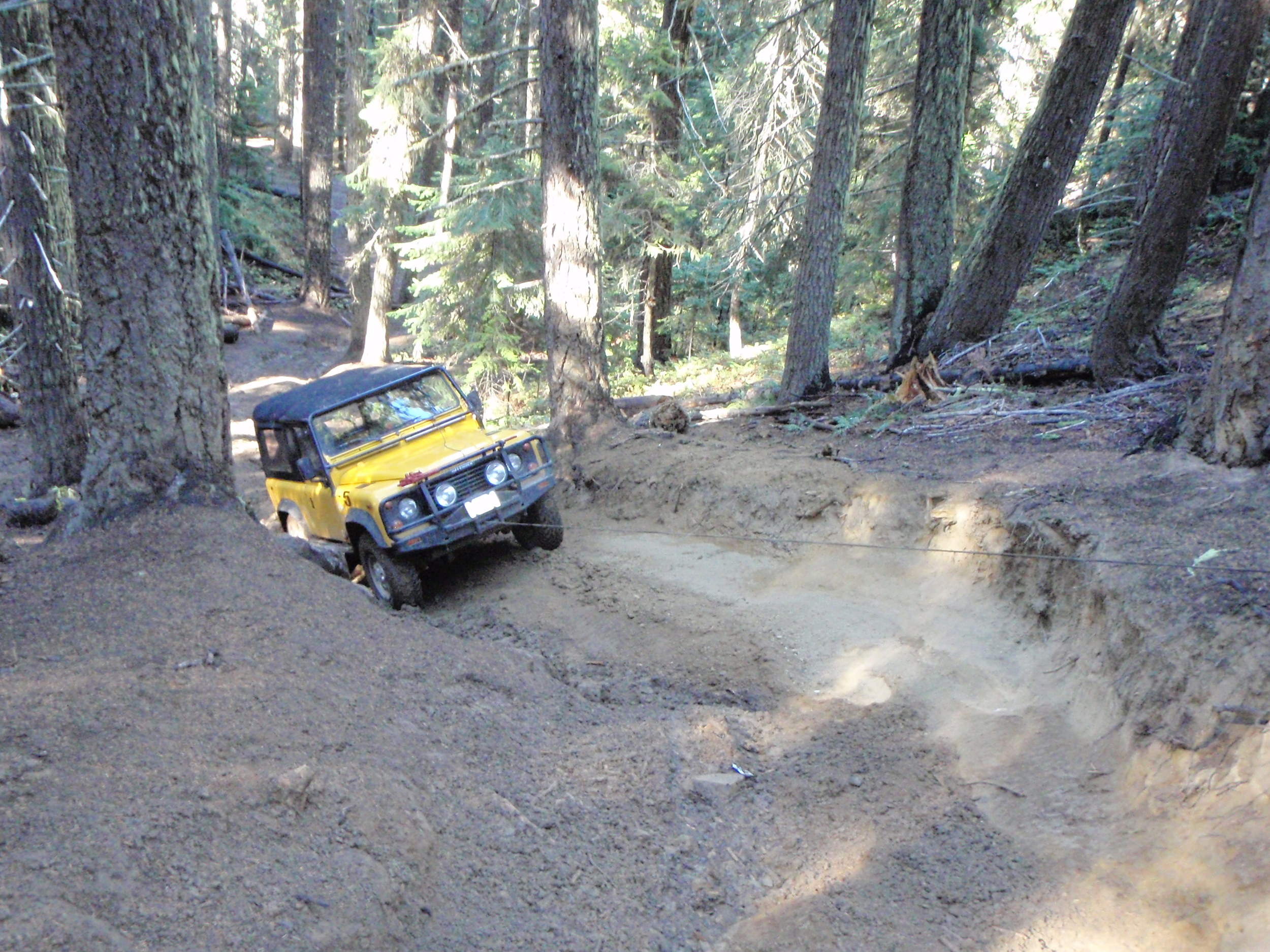 Down in the forested valleys we had a harder time with traction. Lar winches up Aardvark Hill.