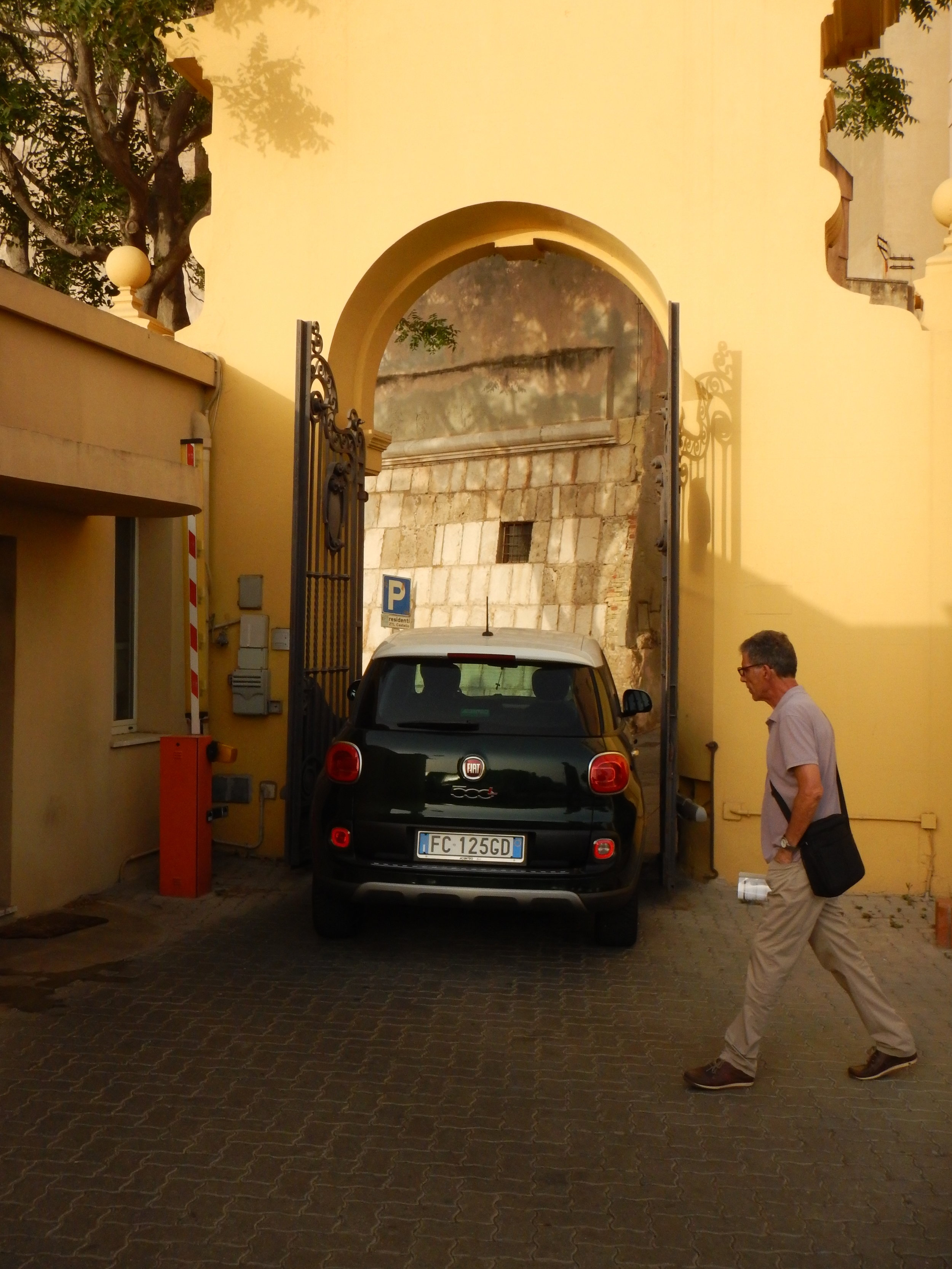 What I love about this picture is that this could only happen in Italy.  Even the miniscule Fiat 500 has no room to spare as it squeezes though this gate.