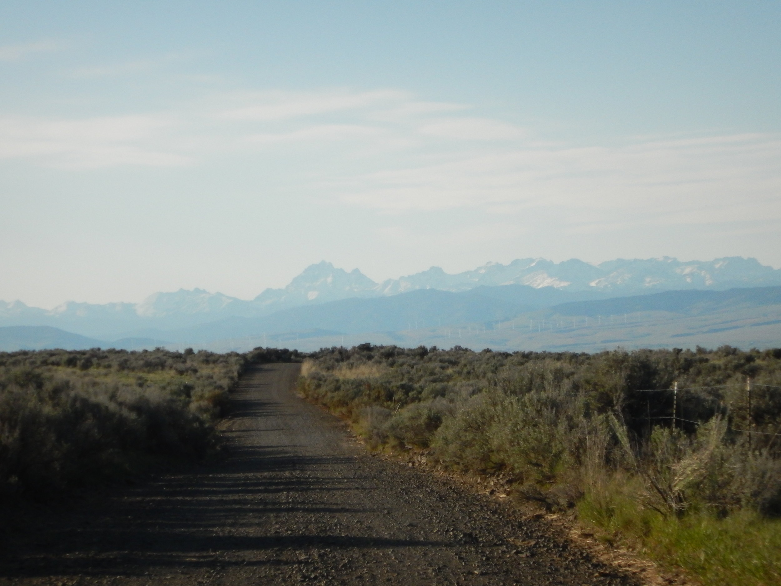 The long road back to Ellensburg with Mount Stuart in center.