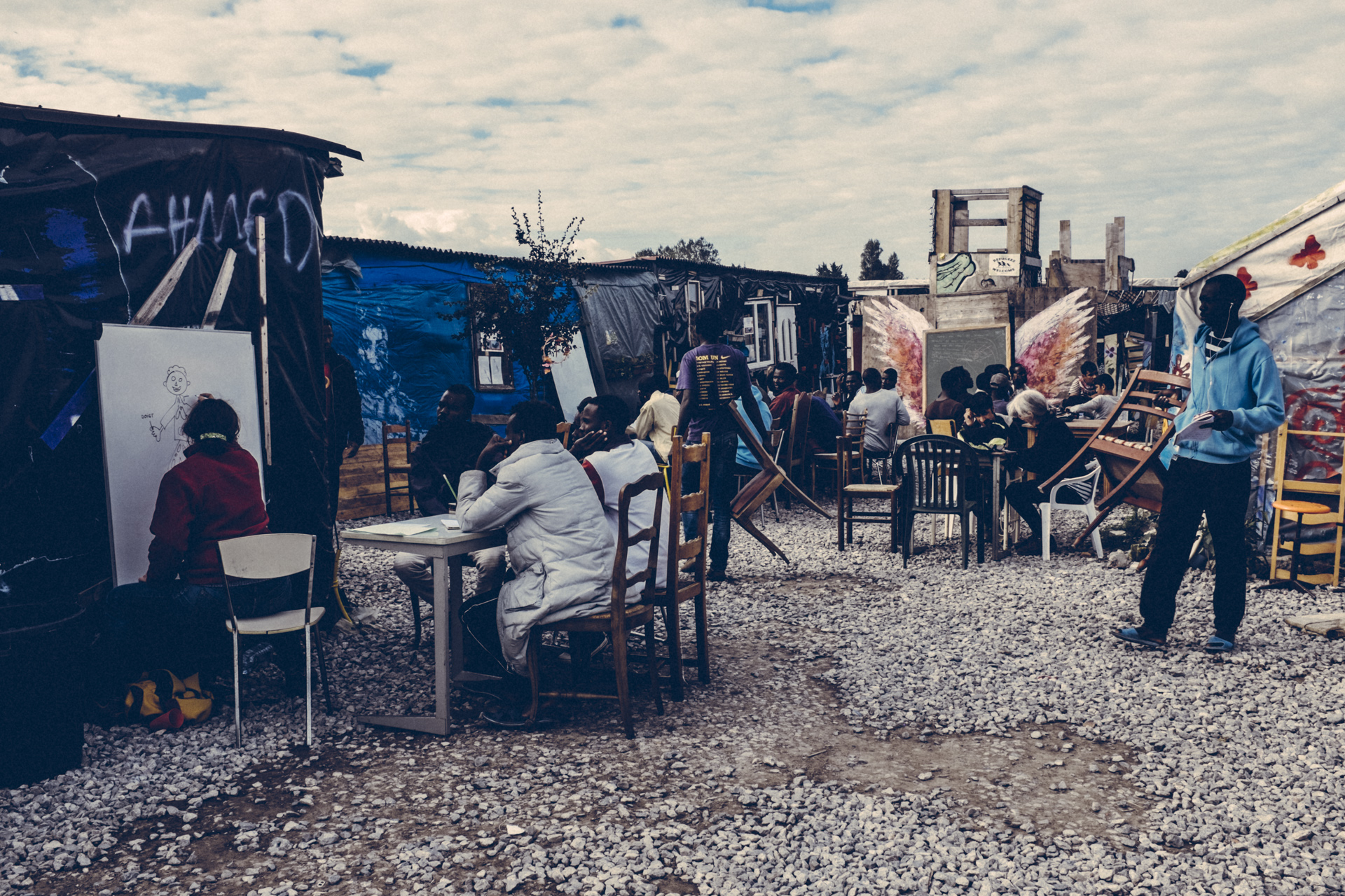 A class in-session at L'Ecole Laique du Chemin des Dunes in the Jungle. Calais, France. 2016.