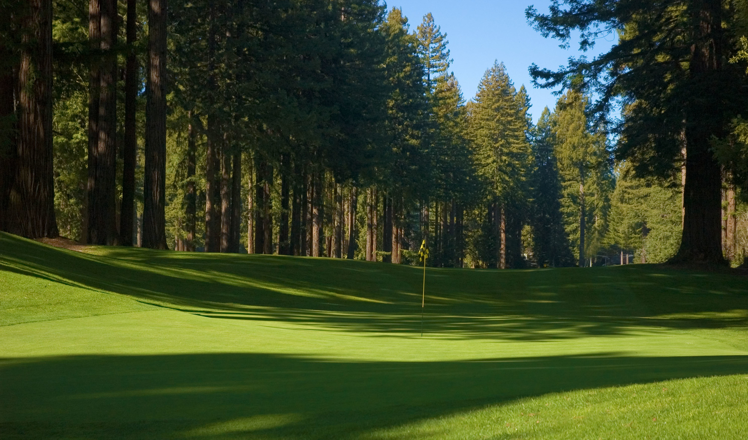 The #2 green rests in a bowl-like area with shifting sunlight throughout the day. © Robert Kaufman