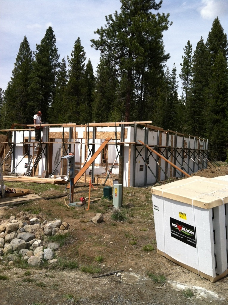 """The exterior walls on this single family home are 11.75"""" thick with a 6.25"""" thick reinforced concrete core. Next the roof system will be installed and sealed off in preparation of our super insulated conditioned crawl space. We can spray down a rigid foam over the crawl space floor, then install our floor system revealing our standard 9' ceiling. You just cannot beat the quality and energy efficiency of construction that Benchmark Development Company provides."""
