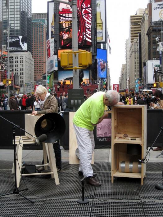 Tony Conrad and Jennifer Walshe performing on intonarumori, Times Square, New York City, Performa 2009