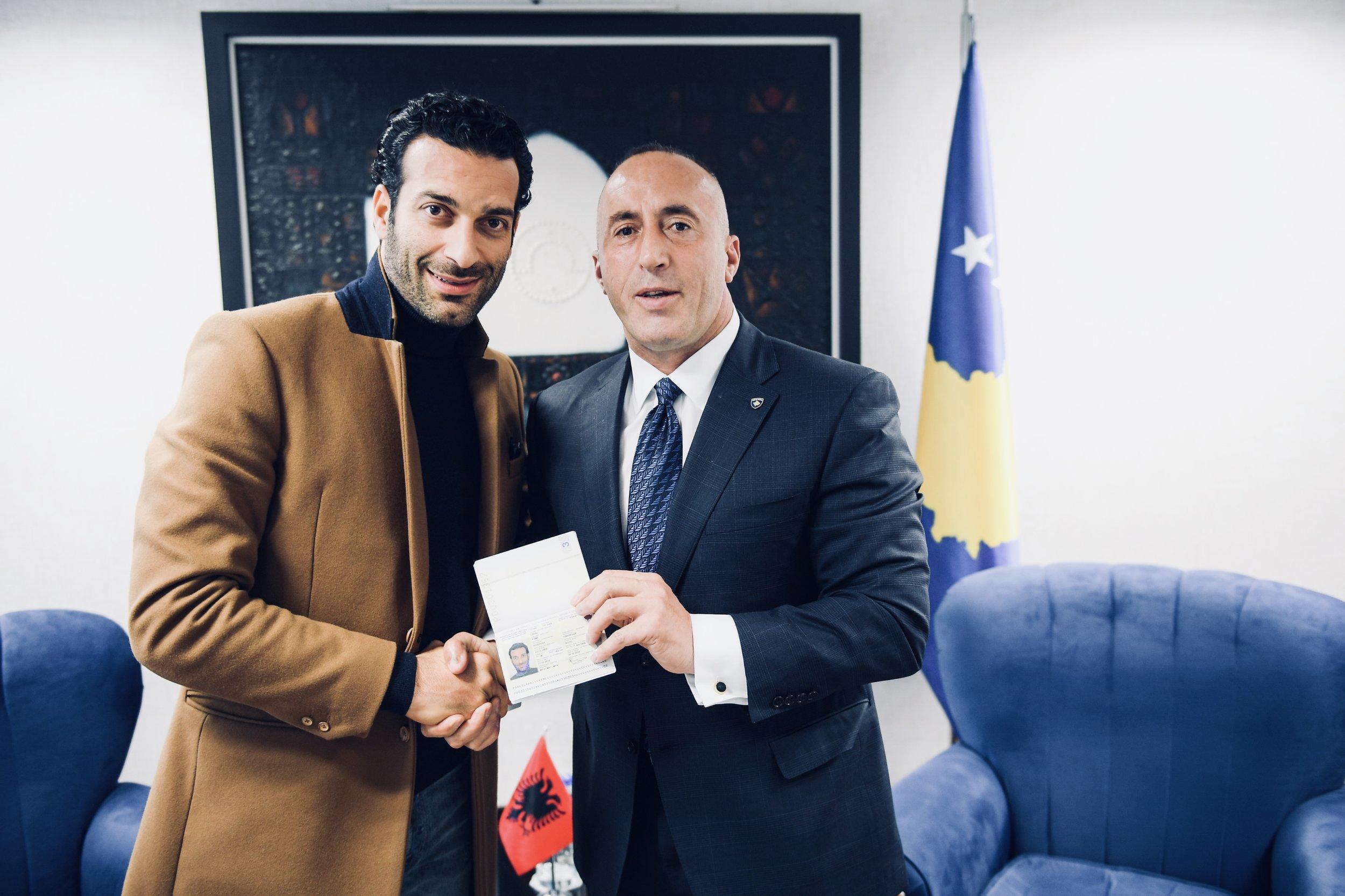 Rame Lahaj receiving diplomatic passport by Kosovan Prime minister, Ramush Haradinaj. Officially during this ceremony Lahaj became global Ambassador for Culture.