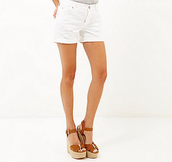 River Island: White ripped ultimate boyfriend shorts $64