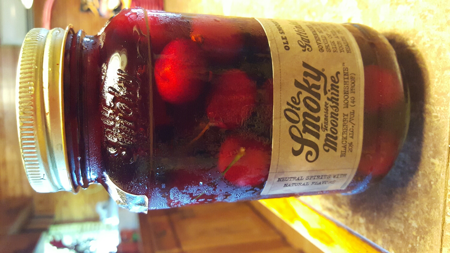 """Tennessee moonshine soaked cherries, banana bread toast, foie gras """"butter""""."""