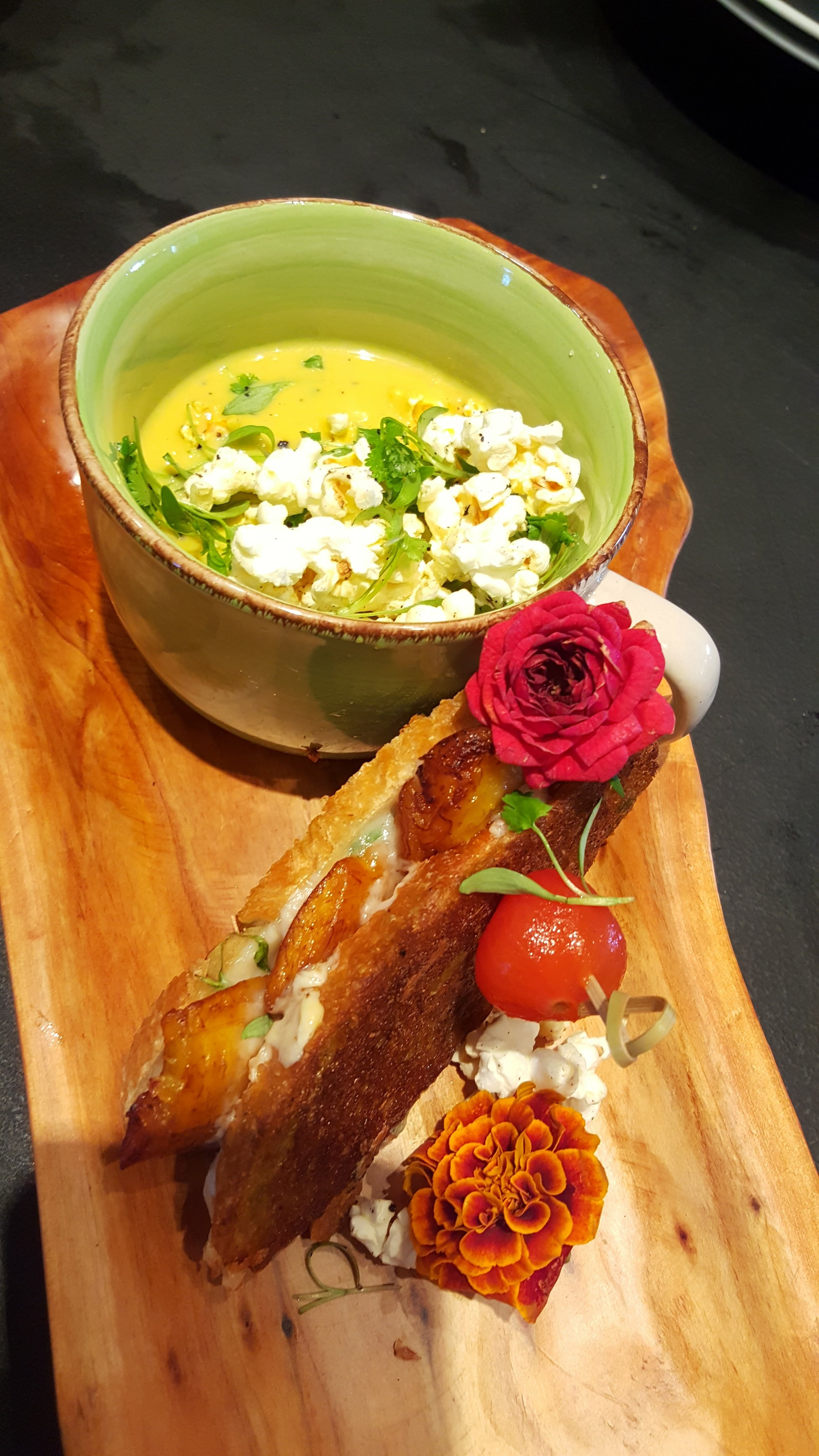 Grilled cheese and plantain sandwich with popcorn chowder