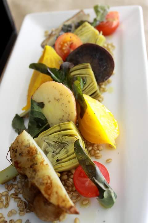 Enjoy roasted and raw vegetables in a salad with barley and red wine vinaigrette over fresh greens.