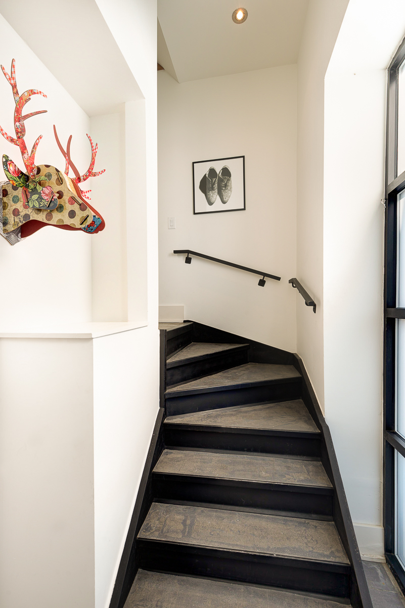 Main entrance, with staircase leading up to loft space.