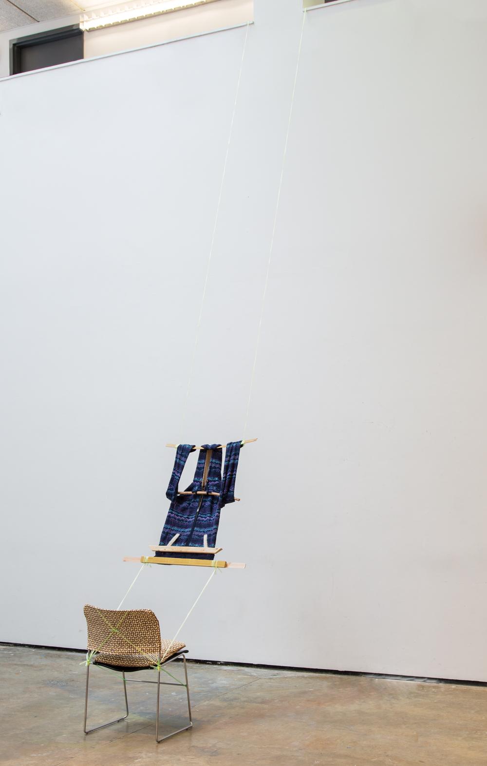 Loom, 2014, hoodie, plastic chord, wood, custom Banig-print fabric chair covering, Yale critique chair, 240 x 20 x 20 inches