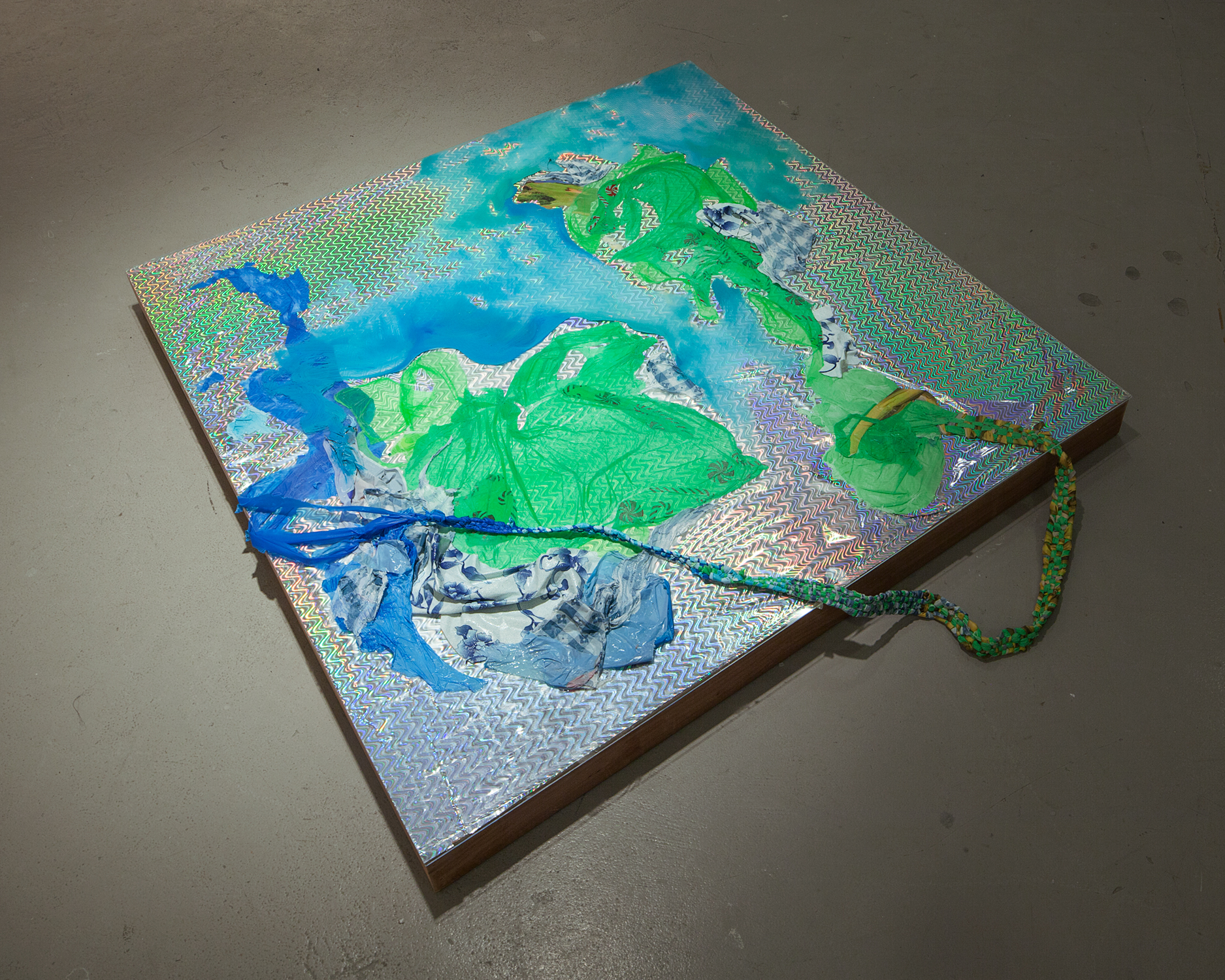 Flashplain , 2015, Oil, plastic, plexiglass, found paper, wood, 48 x 48 x 4 inches