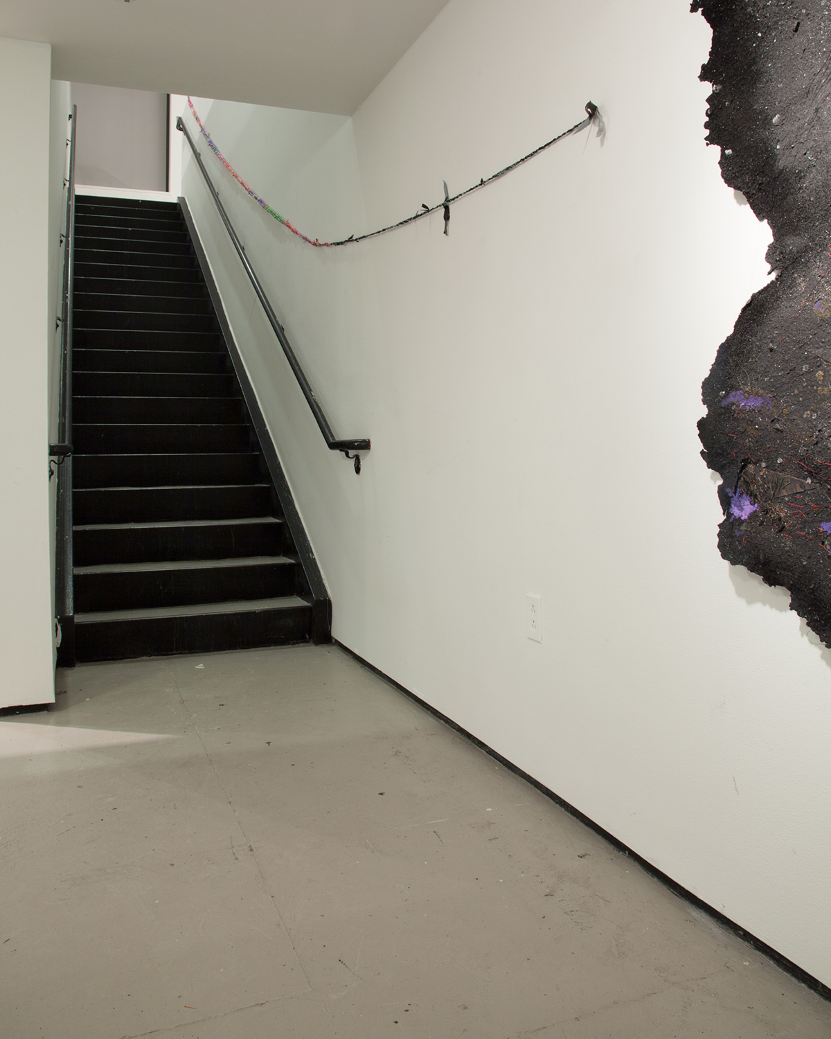 End of installation pointing to sculptureby Brandon Coley Cox