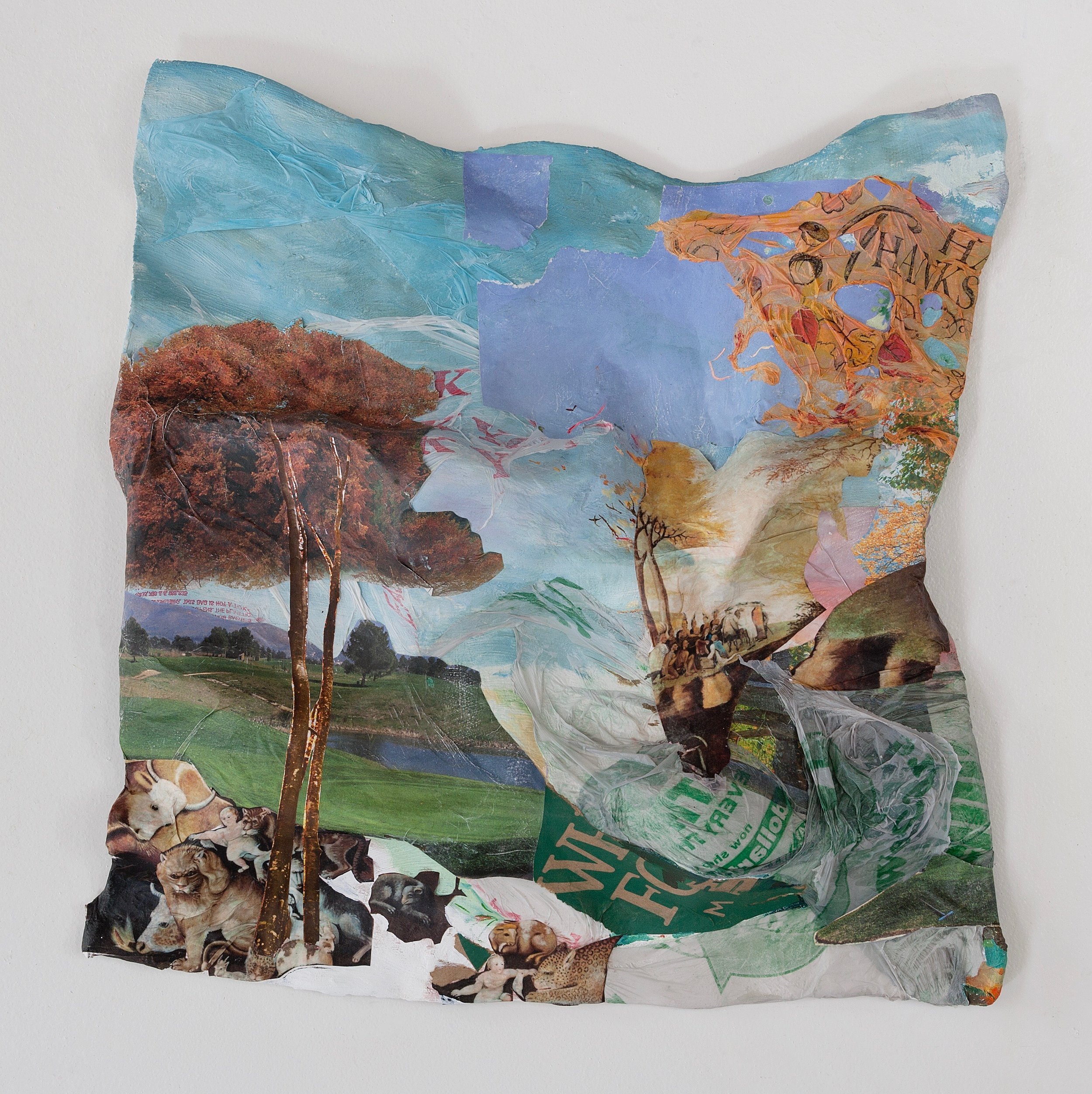 """Pieceable Kingdom , 2017, oil, plastic Thanksgiving tablecloth, digital print of Edward Hicks' 1834 Peaceable Kingdom, Whole Foods bag, Dollar Tree bag, """"We Care We Recycle"""" bag, golf course calendar, Thank You Thank You bodega bag on plaster, aluminum and wood, 20 x 19 x 3 inches"""