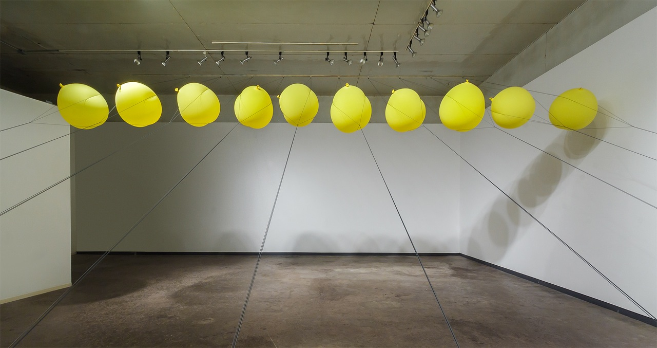 Slow Release   2014  balloons, parachute cord, hardware  dimensions variable