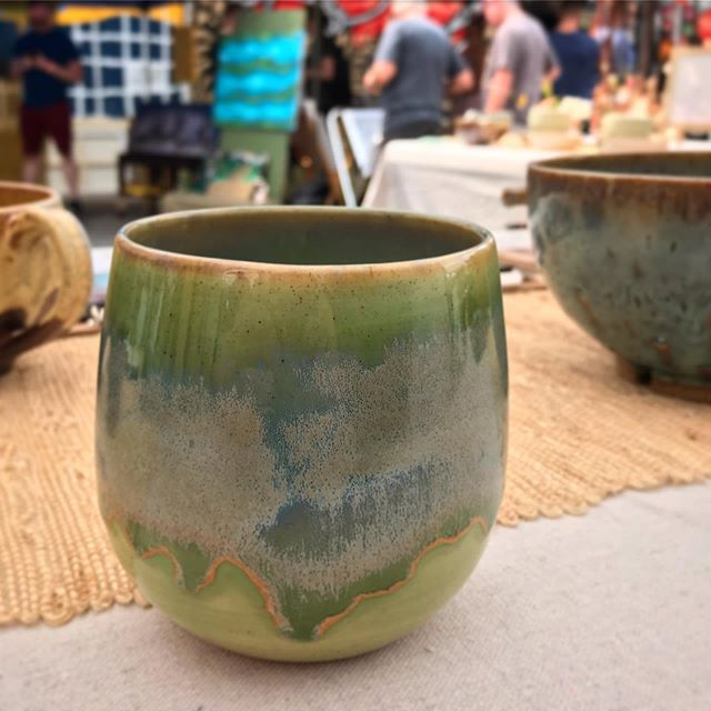 I'm truly obsessed with this new glaze combo. It's looking spectacular in the sun here at Art for the Cash Poor! Come swing by my booth this wine cup could be yours!  #aftcp #aftcp2019 #artforthecashpoor #ceramics #pottery #glaze #craftfair #phillymade #maker