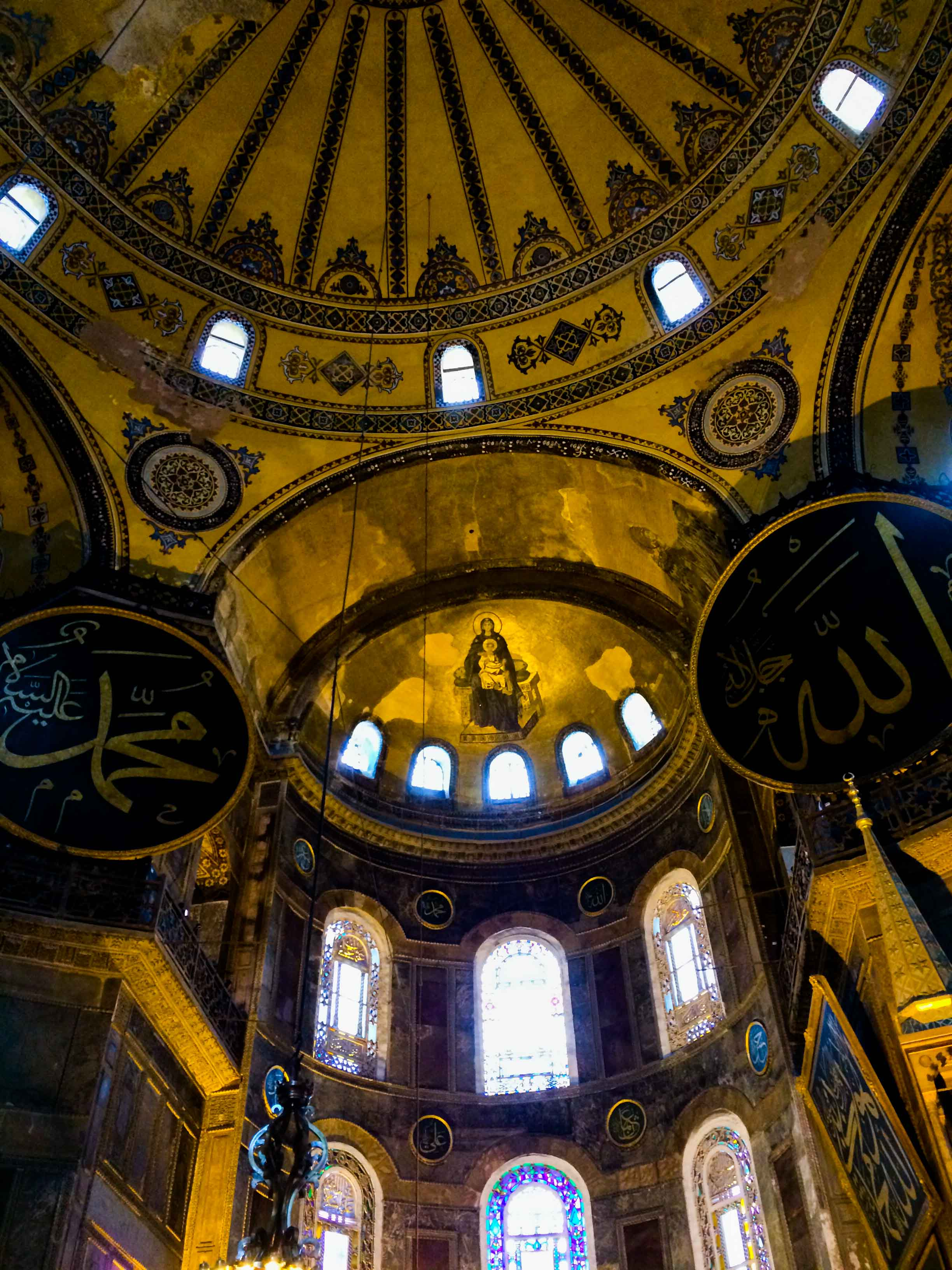 The original mosaic work that adorned the cathedral that once was Aya Sophia being recovered underneath the plaster that was laid over when it was converted to a mosque in the Ottoman times.