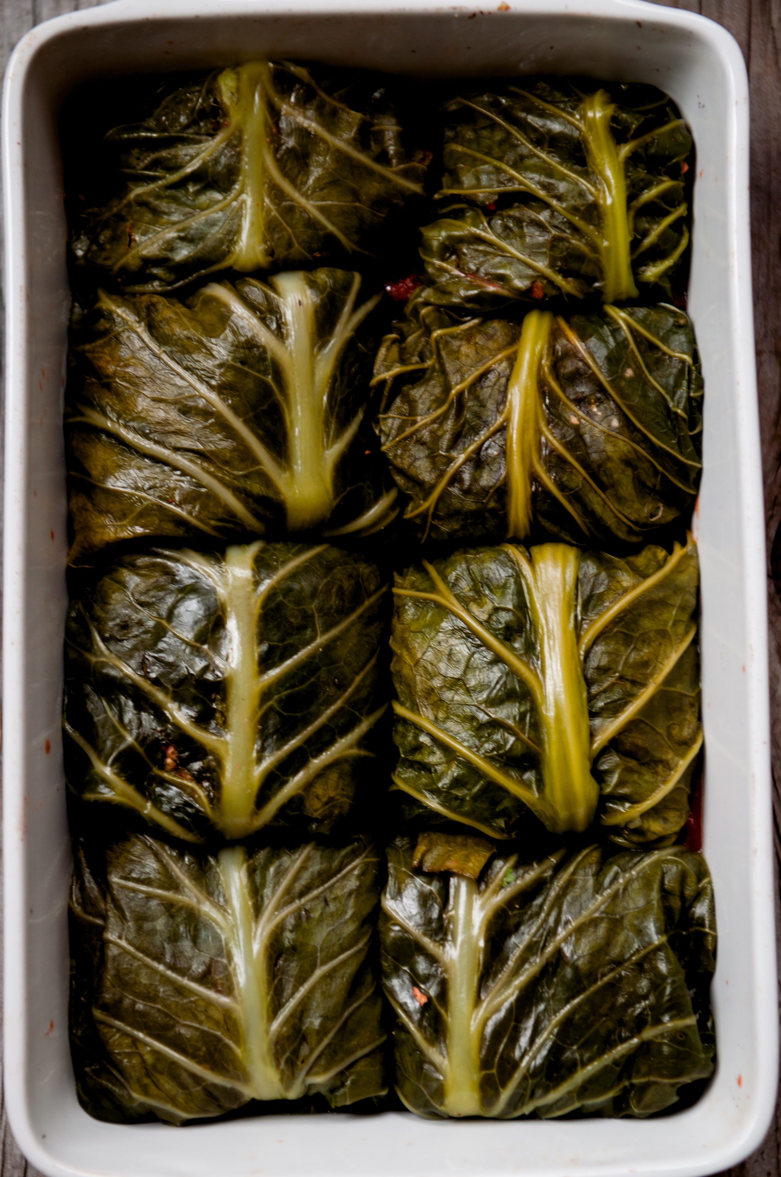 These steamed collard green leaves are wrapped around a stuffing of brown rice cooked with beets and a little stock. Ready to be sauced and baked for a scrumptiously hearty meal.