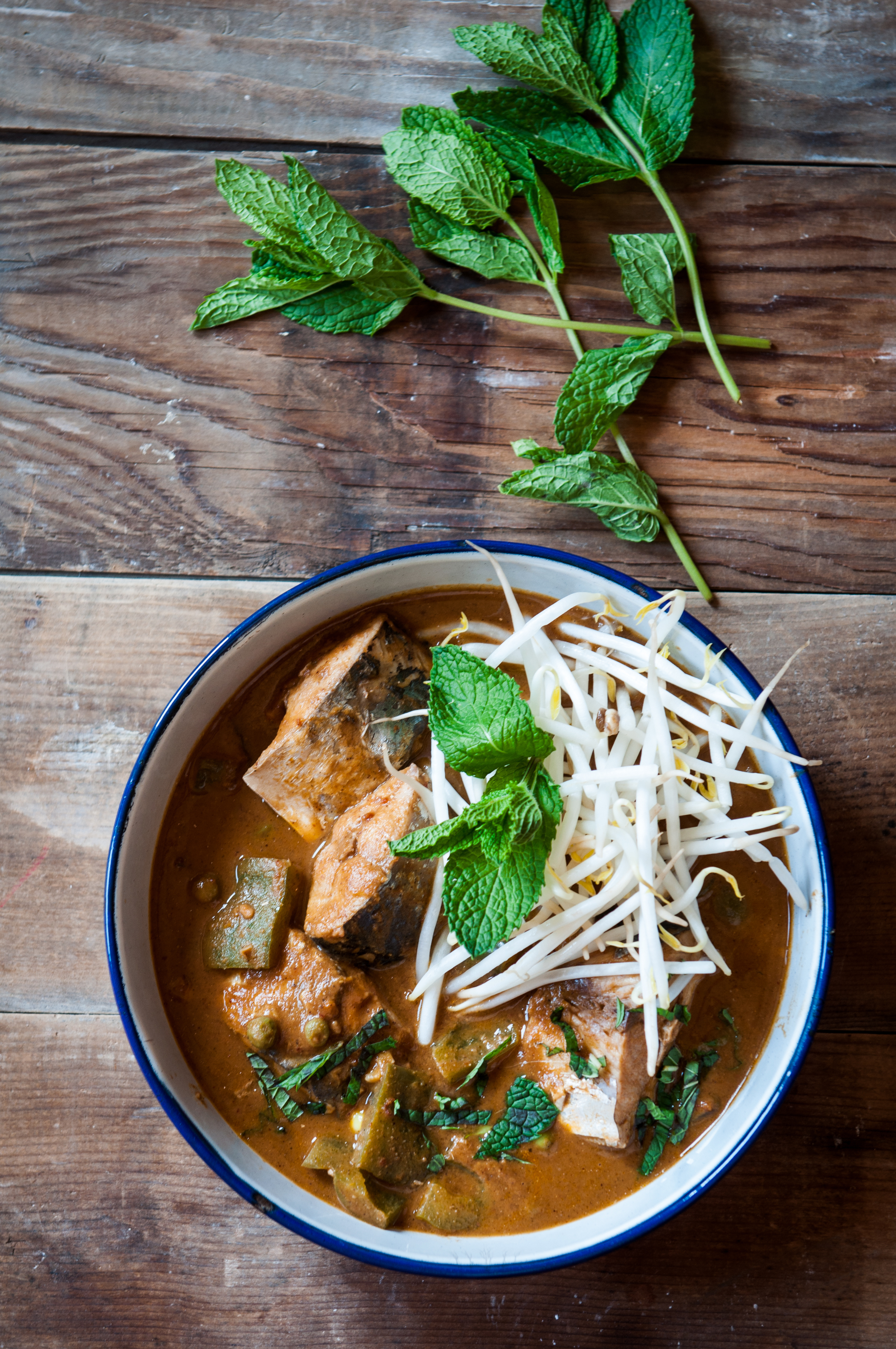 Street style Asian fish curry made with freshly roasted whole spices and dabs of almond butter.