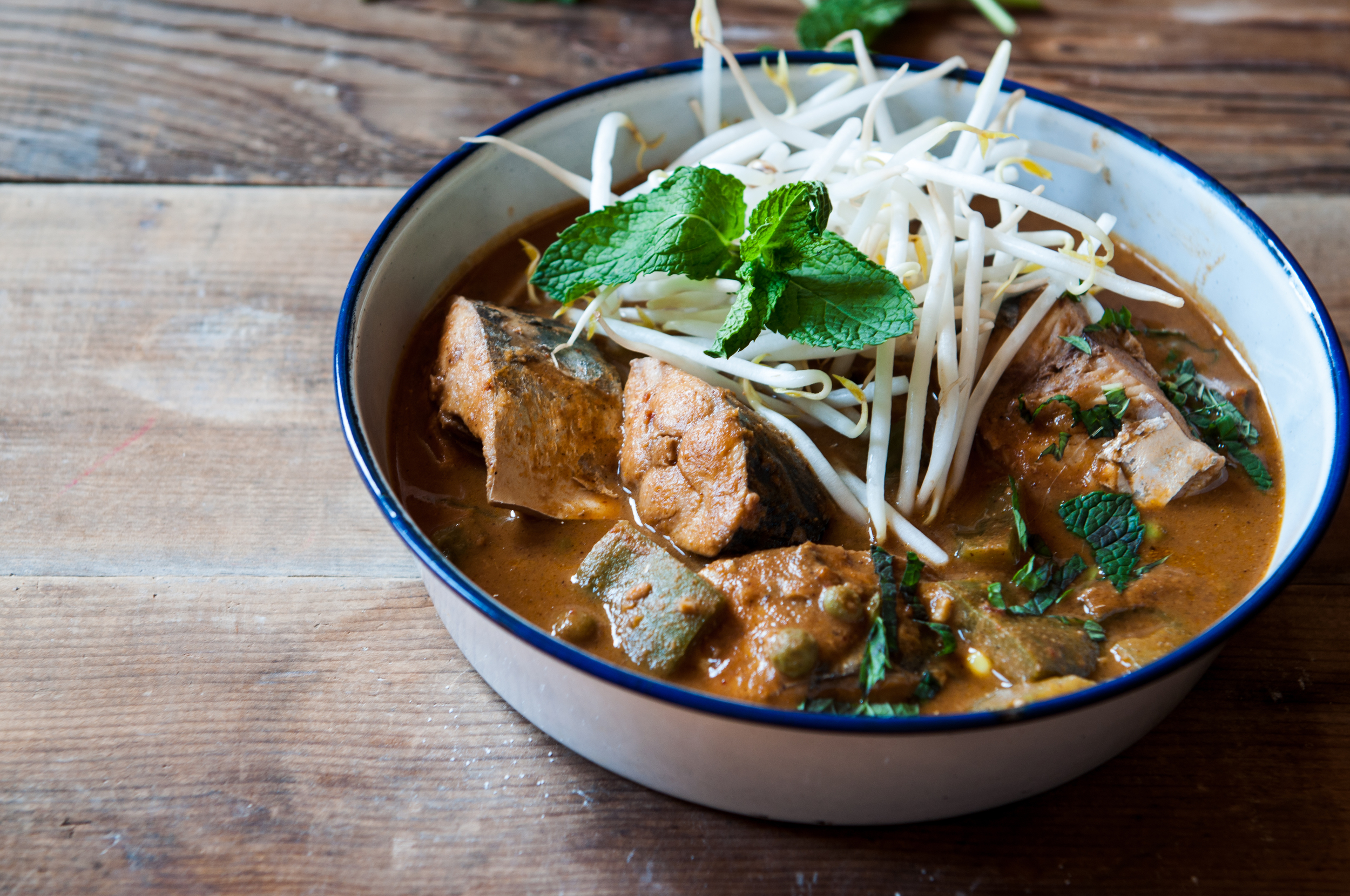 This is a straight up, honest blue collar fish curry cooked with spices that leave you with no doubt of having eaten, full and satisfied. It brings back the memories of fish markets, screaming fishmongers, roadside food havens and the earthiness of a day's labor.