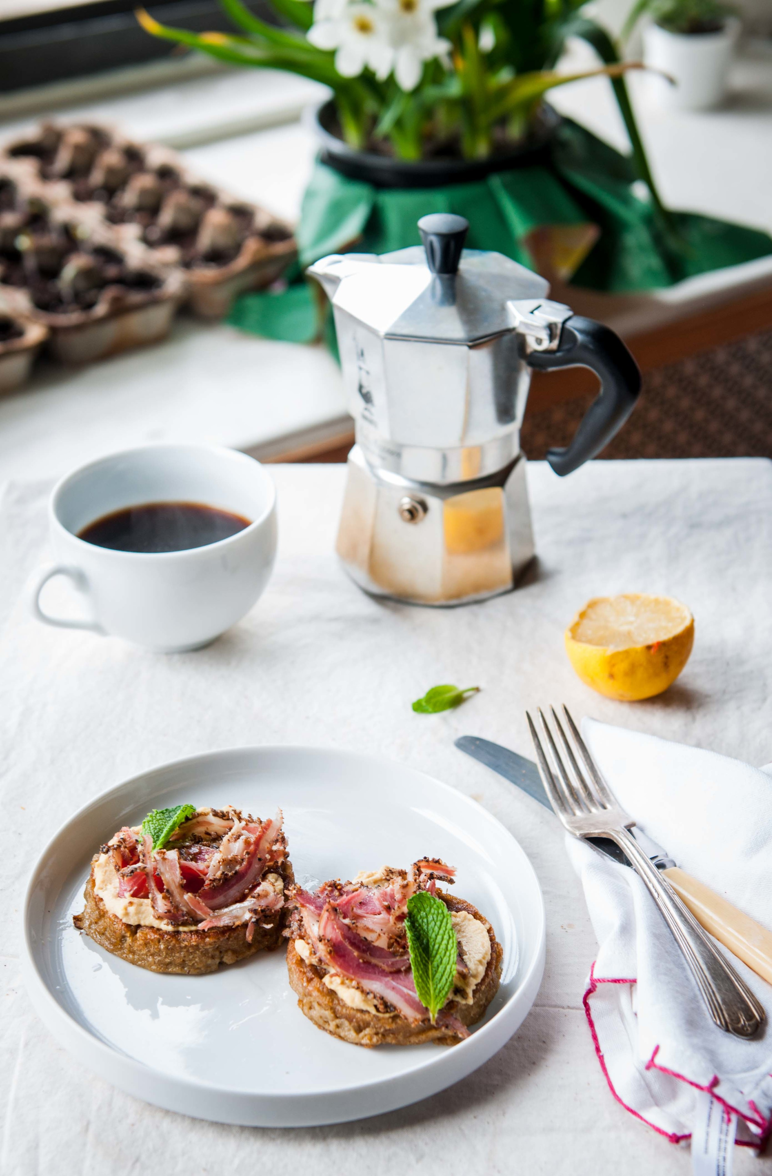 Tartines made with rice and mung bean crumpets, hummus, and, lamb proscuitto and fresh brewed coffee!