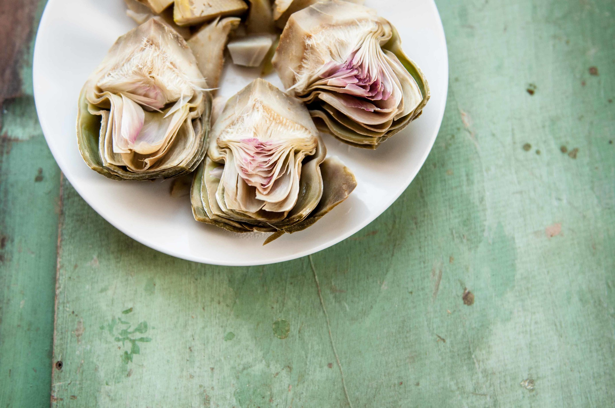 Artichokes blanched in lemon water salted generously. The lemon is key!
