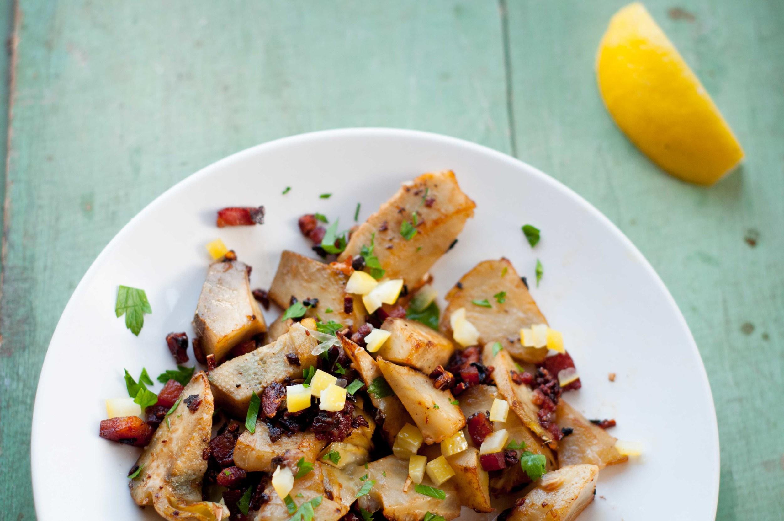 Pancetta sautéed artichoke hearts salad with diced boiled lemon.
