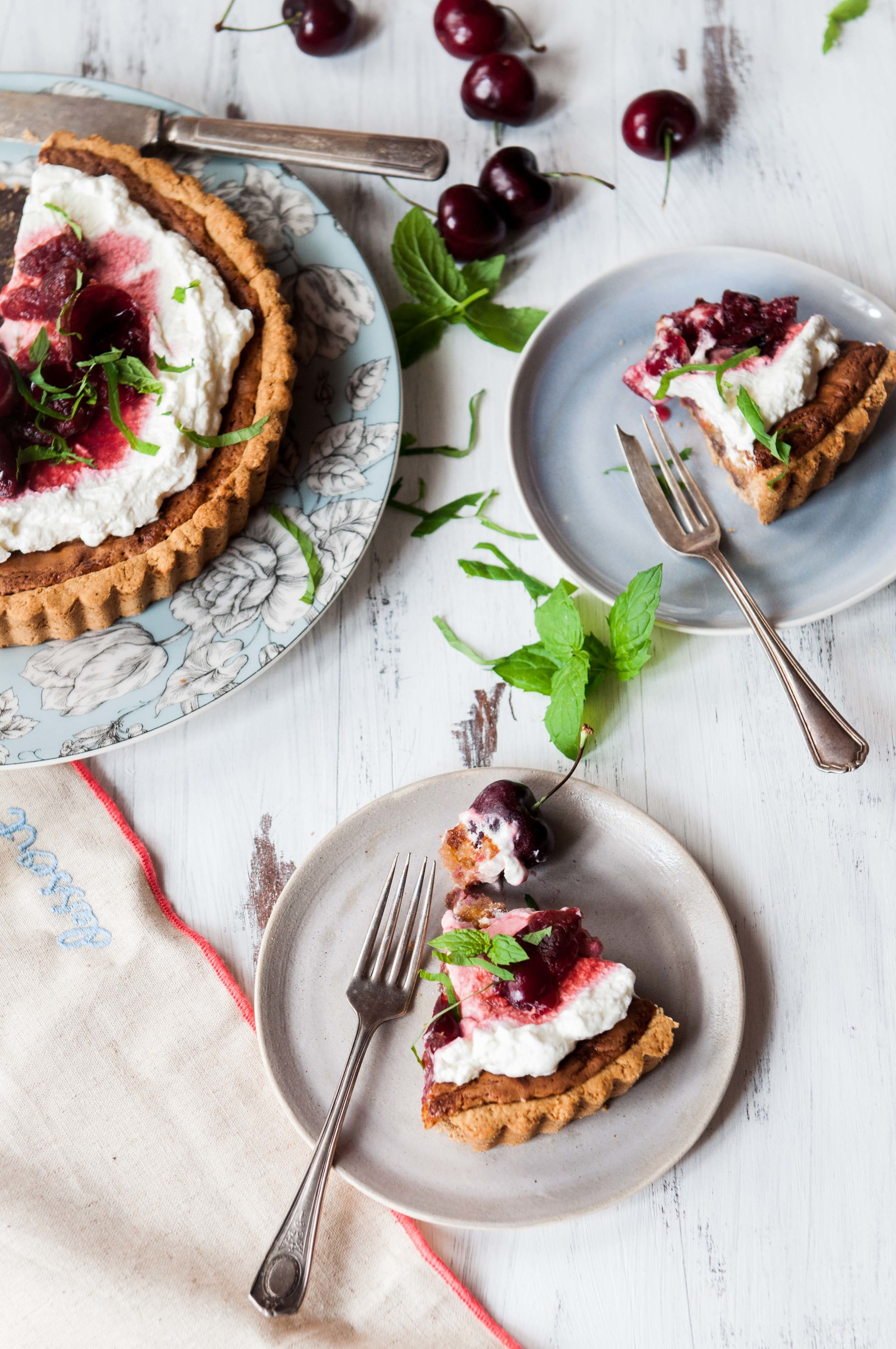 sliced-cherry-tart-brandy-cream-frosting