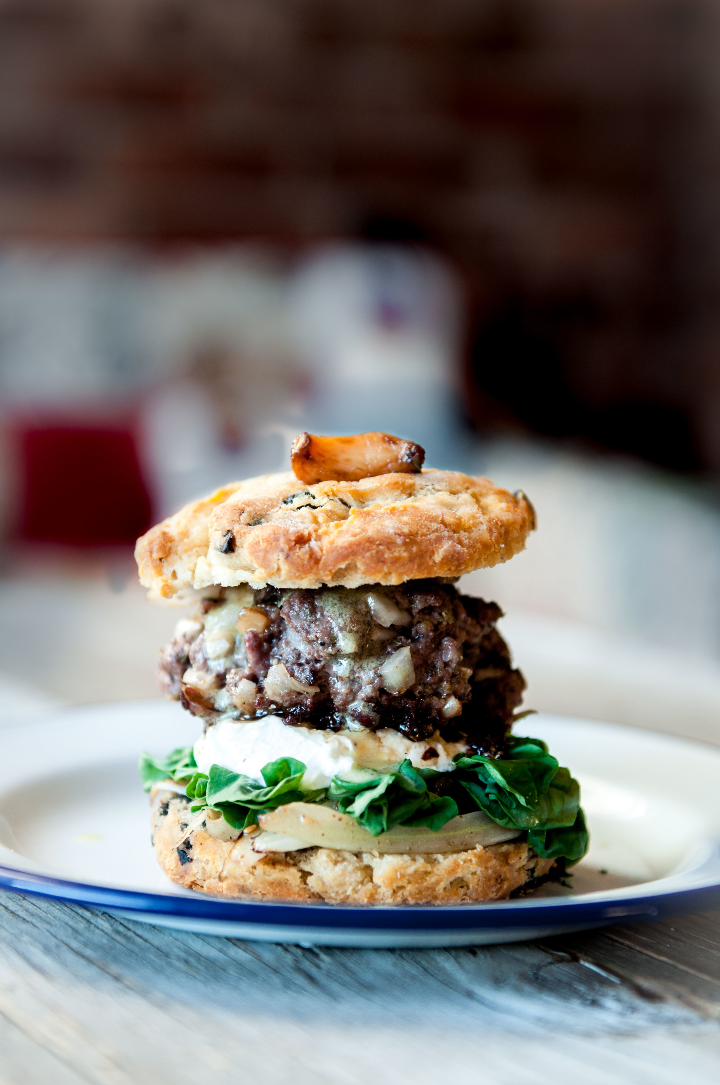 fennel and beef burger sandwiched in gluten free olive scones