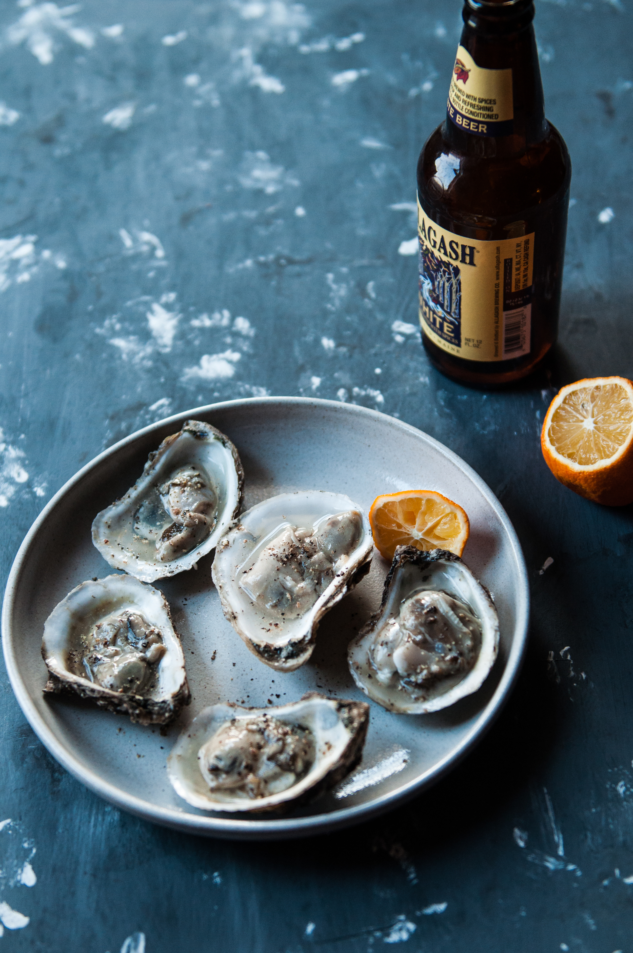 Fresh oysters in their own brine with a dash of pepper and squeeze of meyer lemon is one of my favorites! It's simple, clean and fresh and what I have slurping on warmer week nights!