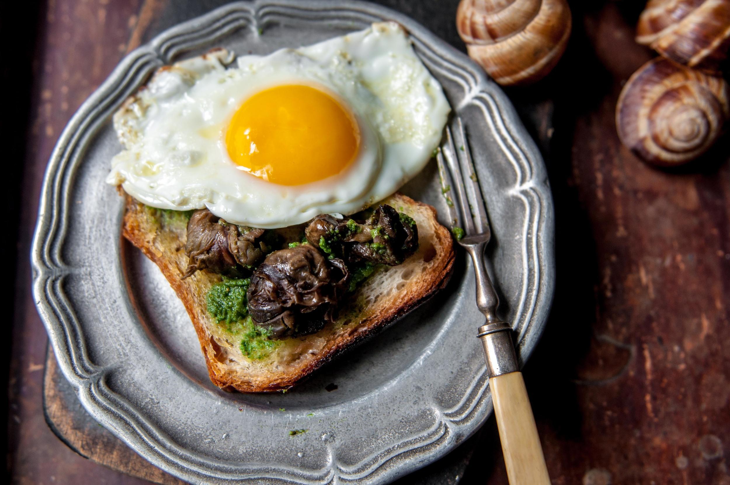 Pesto Roasted Escargots on Toast + Fried Egg #PutAnEggOnIt