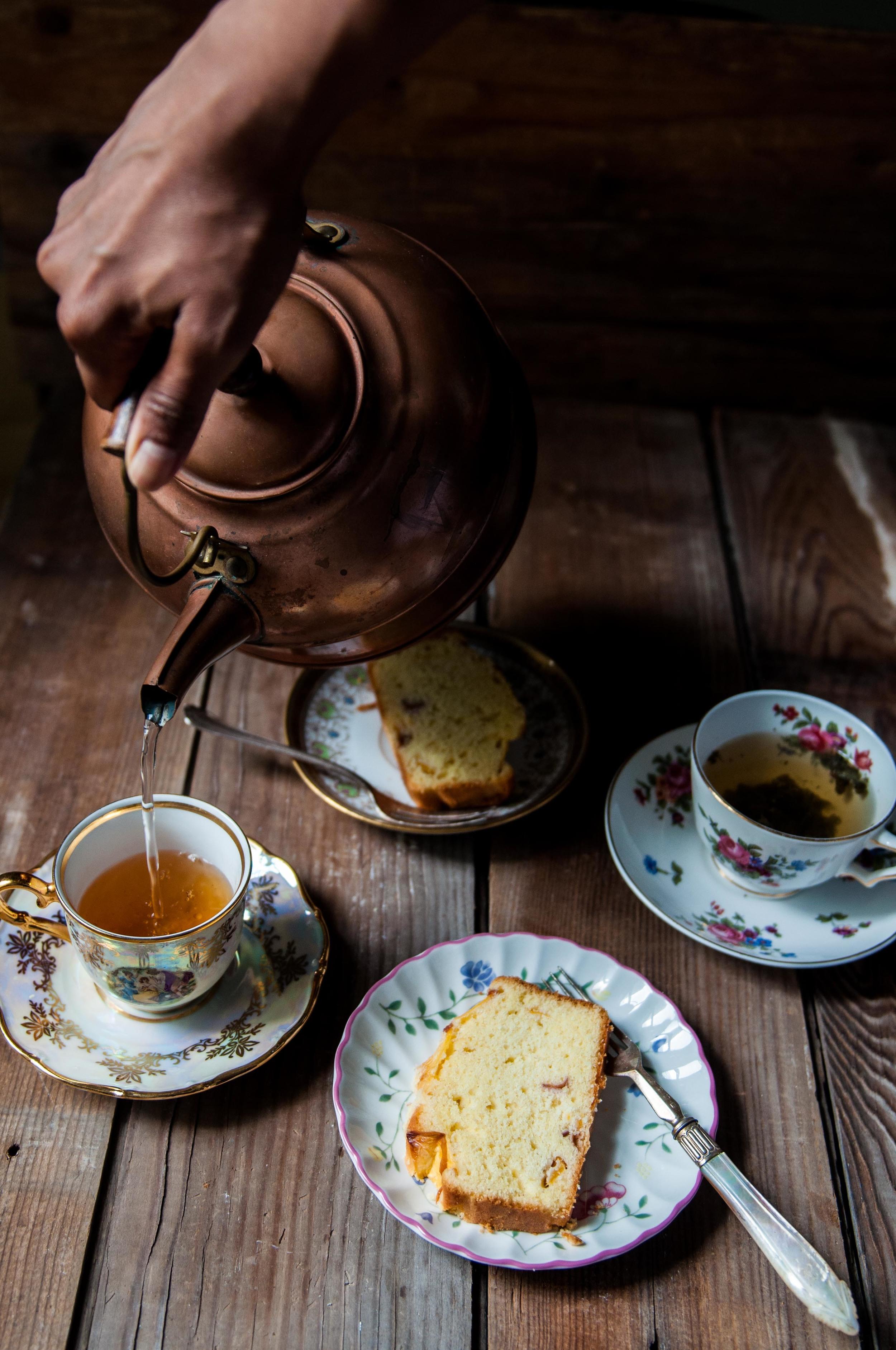 Pouring tea for Gluten Free Peach Pound Cake