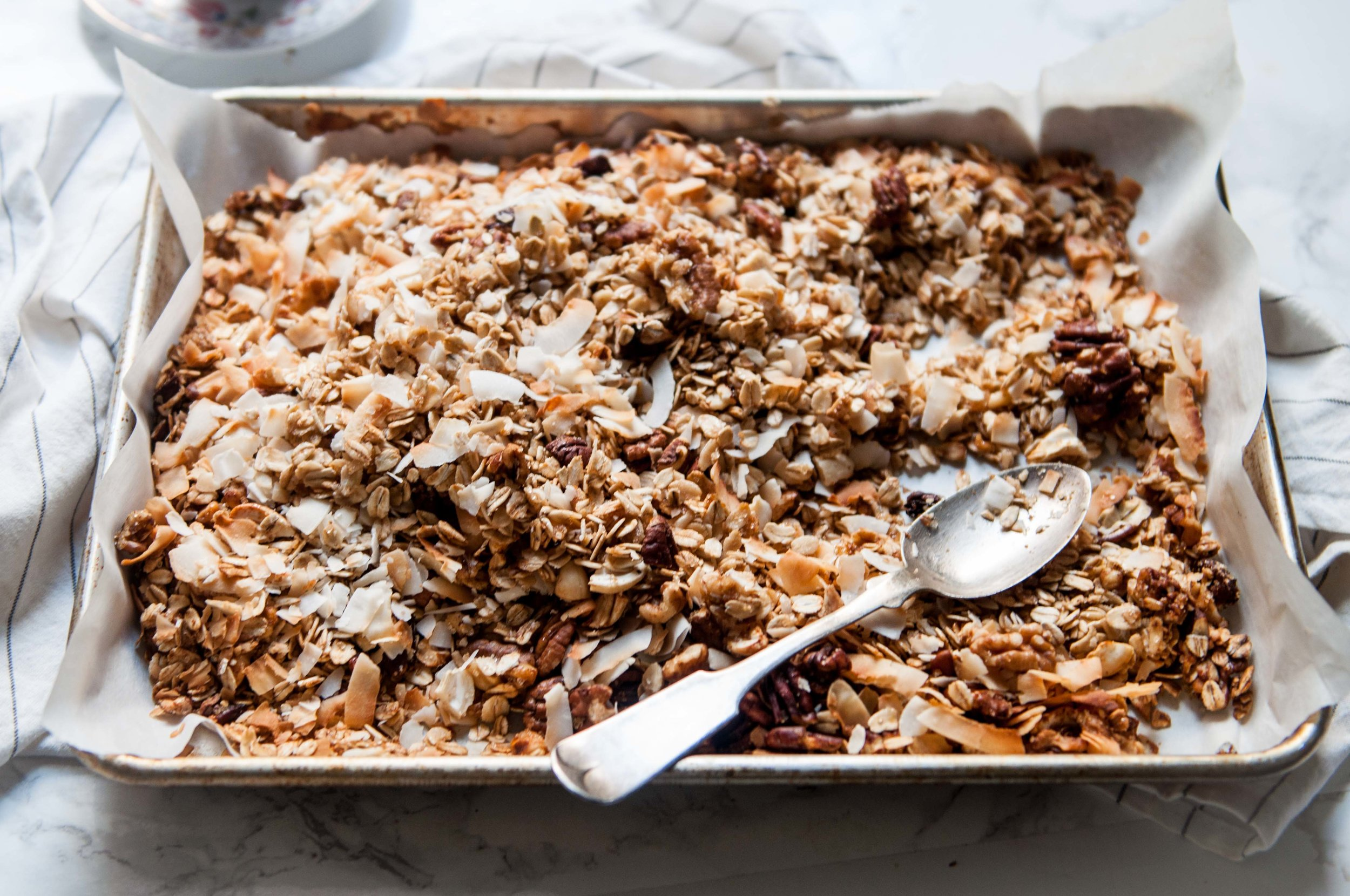 Baked granola with roasted oats, raw honey, cashews, pecans, walnuts and coconut flakes.