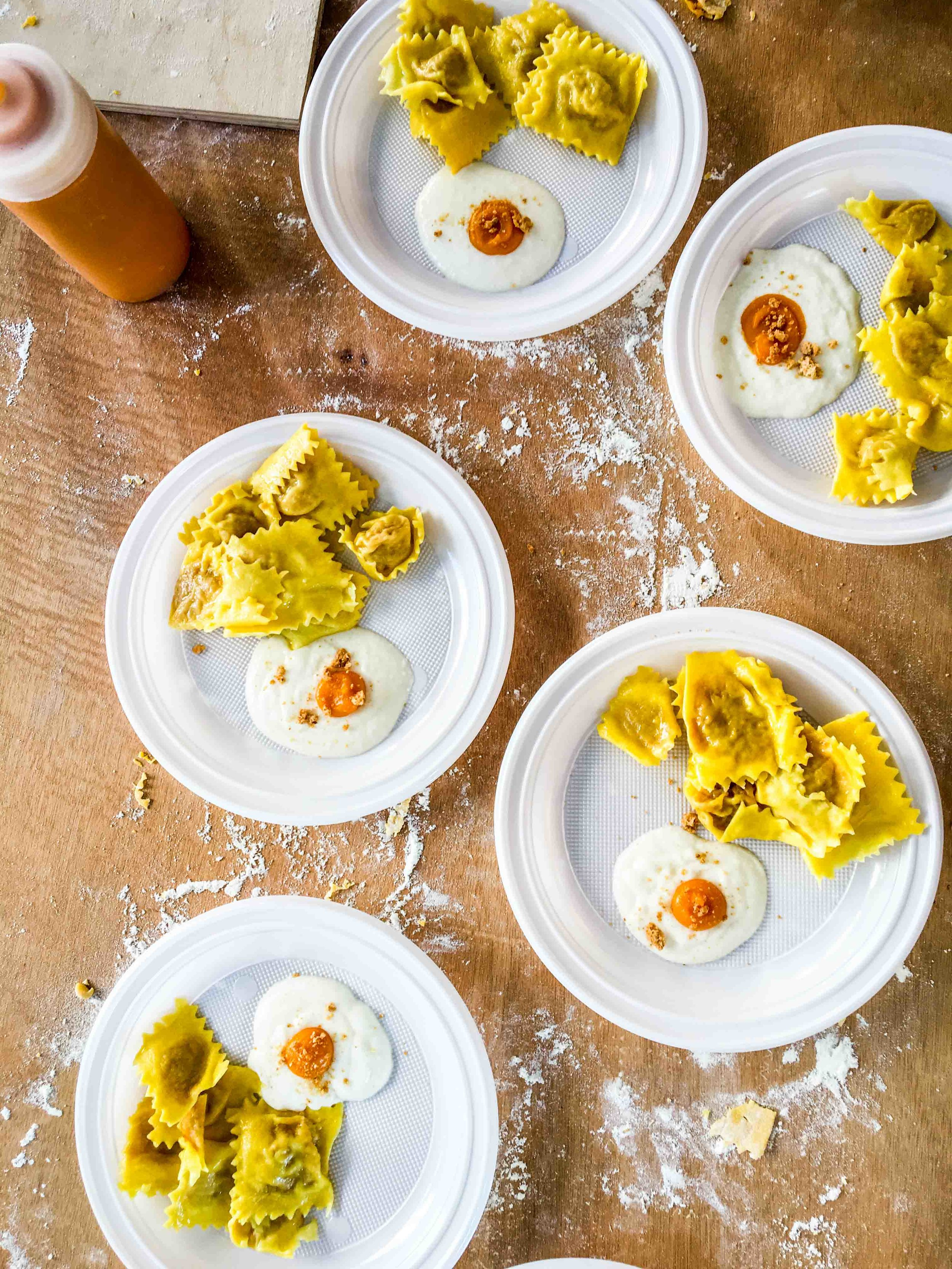 A traditional Reggio Emilia dish of tortelli stuffed with pumpkin puree and amaretti crumbs and sauteed in butter, also reinterpreted as parmesan cream and pumpkin puree fried egg!