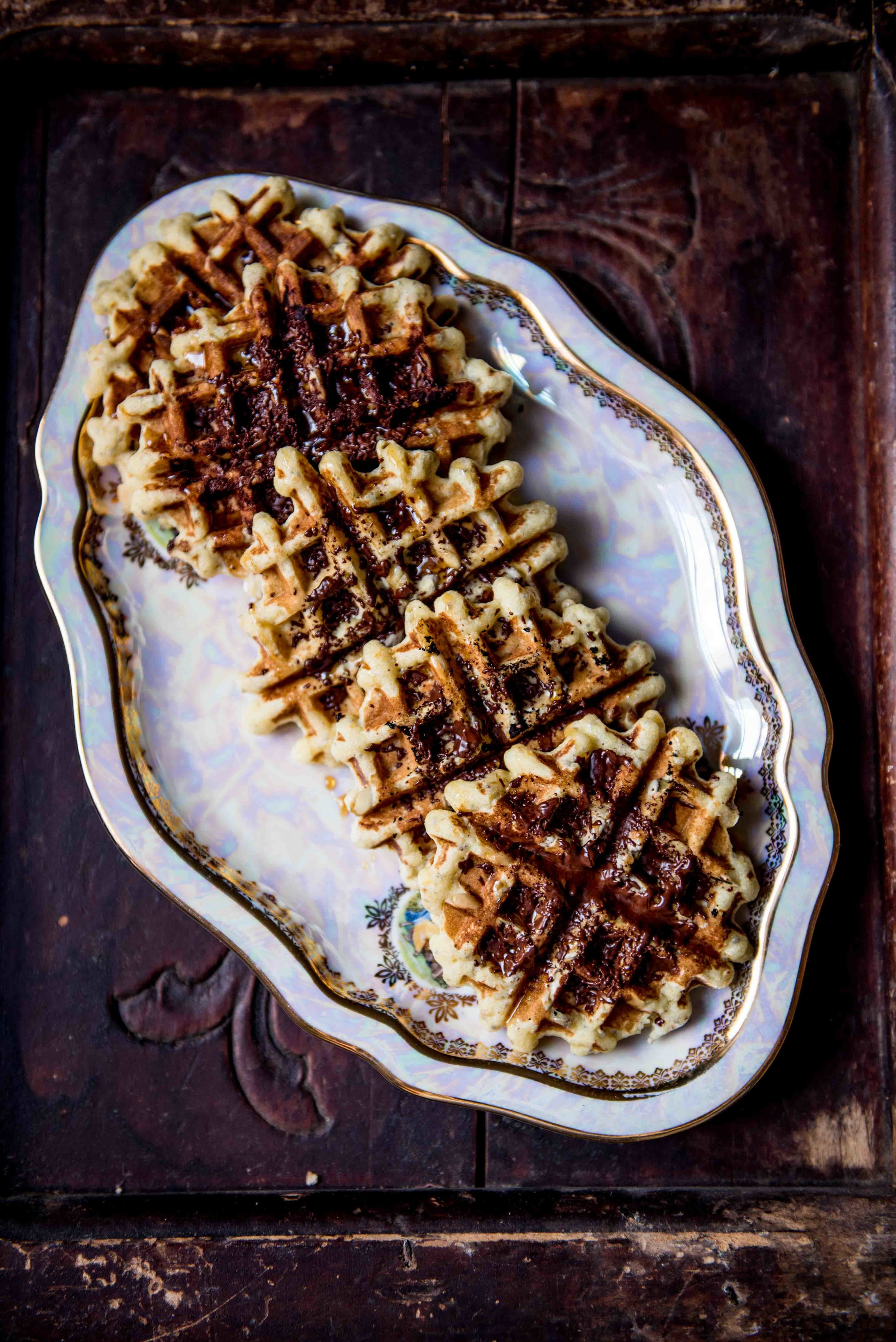 Almond Flour waffles, heavily seeded and spiced with orange sugar and sprinkled with chocolate flakes while still warm... Ah Joy!