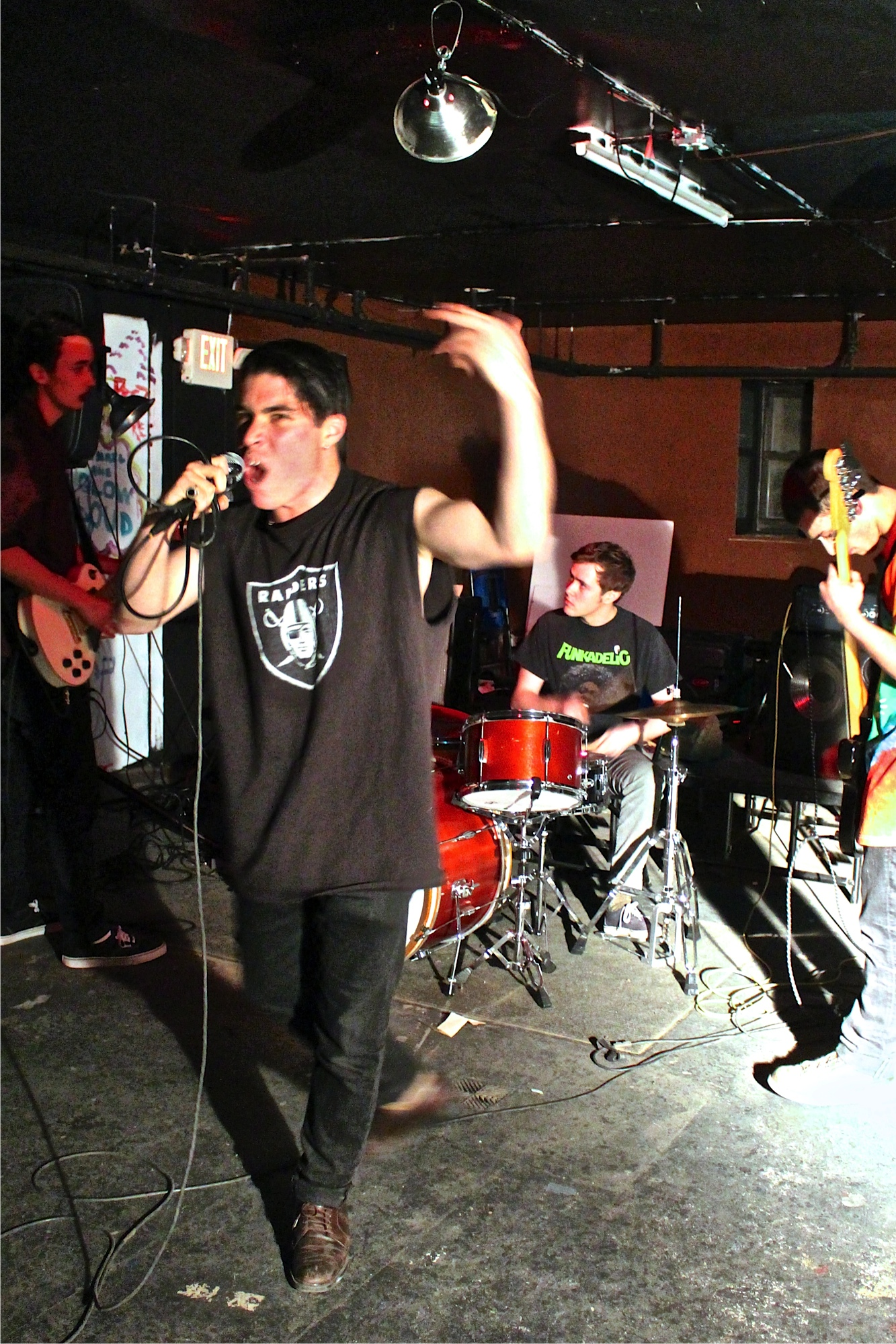Nachi Conde-Farley '14, Will Peterson '14, Nate Ostiller '14, and Gabe Salomon '17 perform at the Worker's Justice Show on March 7