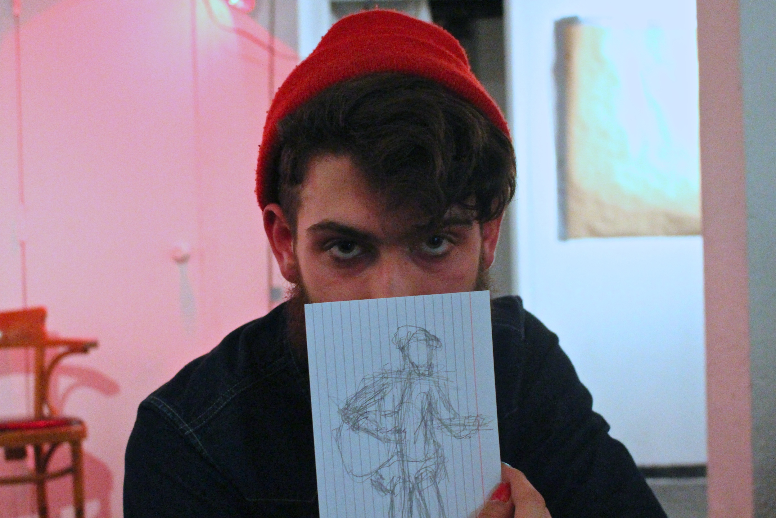 Guido Castellani '14 holds a sketch drawn during his performance