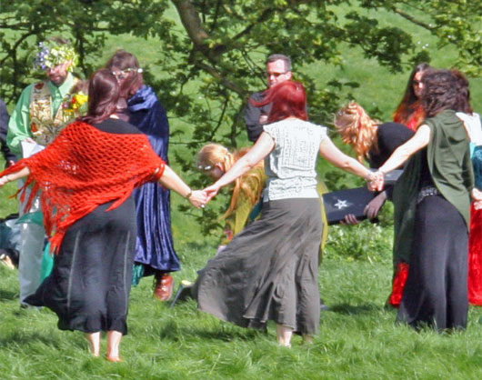 Individuals perform a handfasting ceremony at Avebury   Photo courtesy Solar
